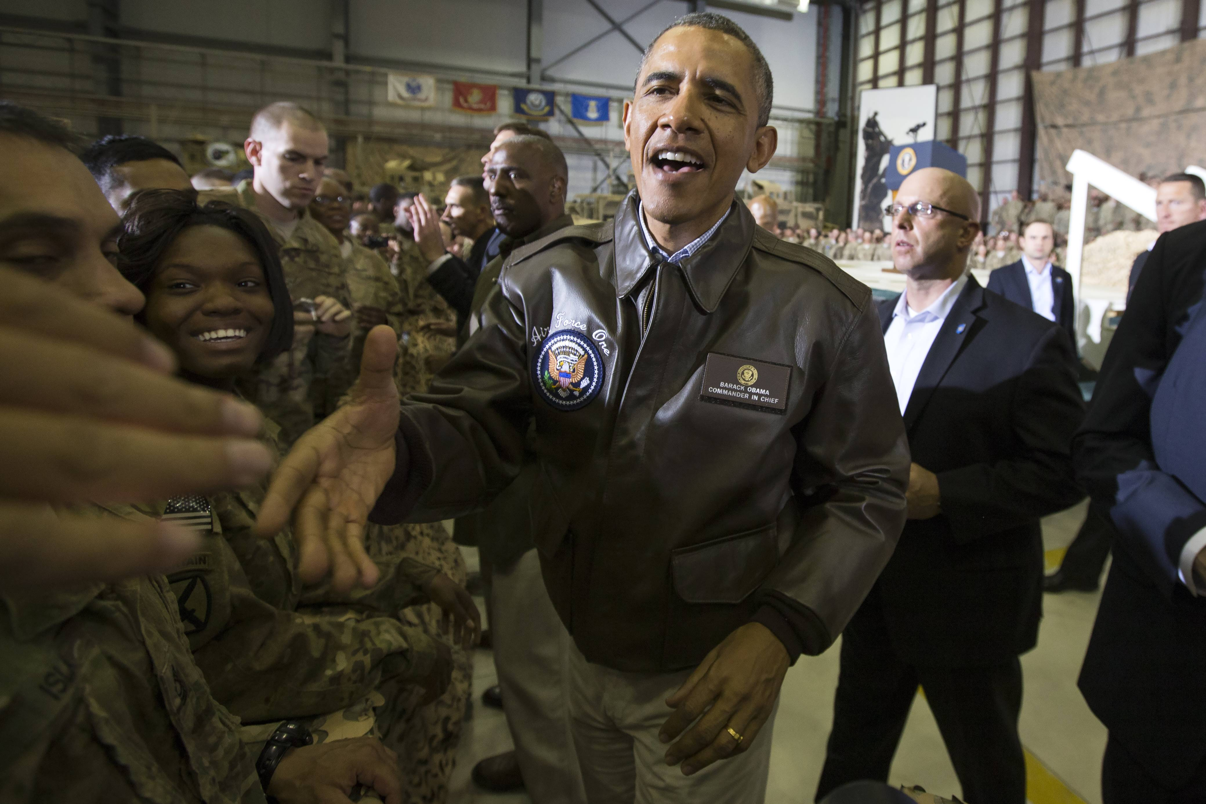 President Barack Obama shakes hands during a troop rally at Bagram Air Field during an unannounced visit, on Sunday.