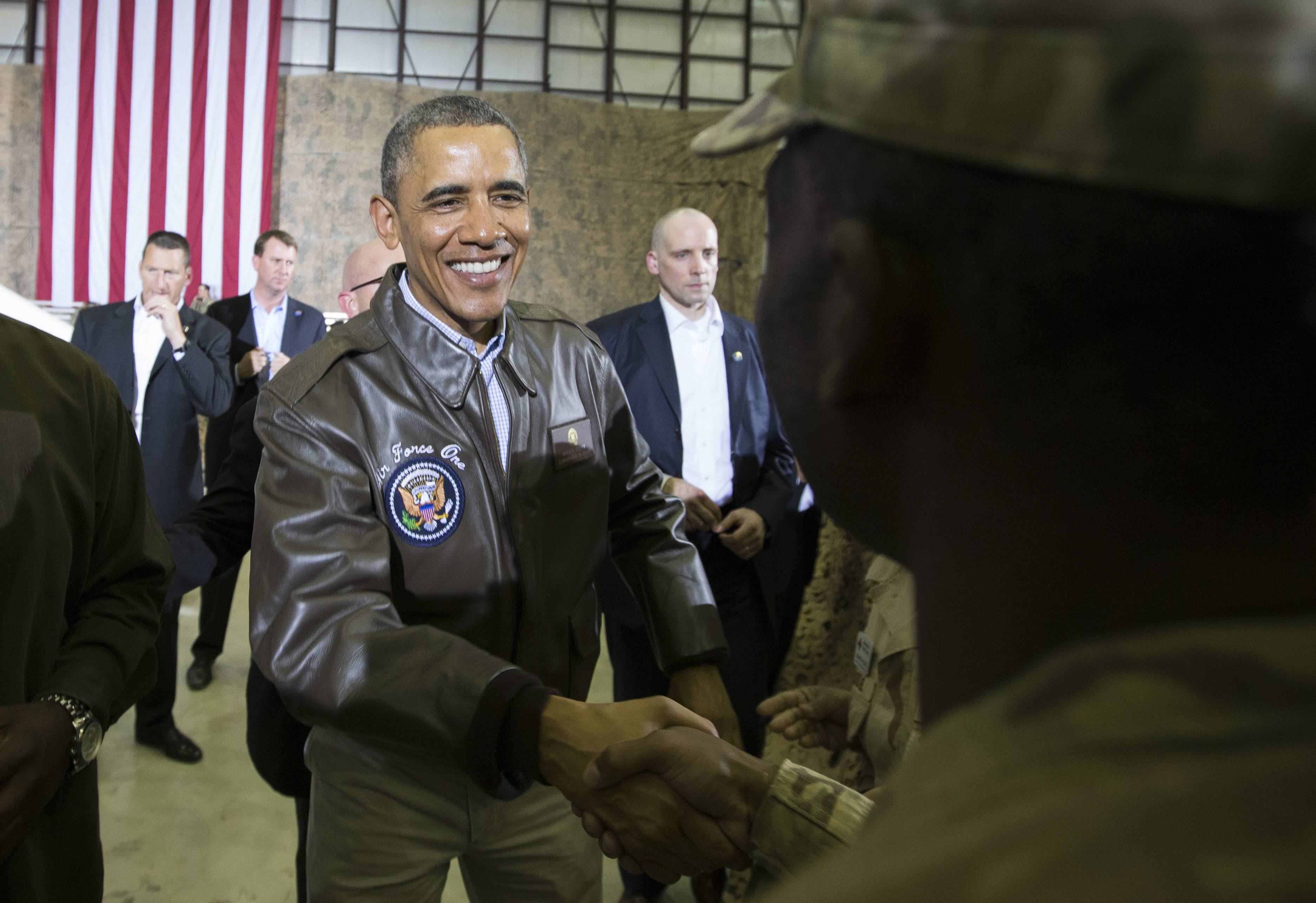 President Barack Obama shakes hands during a troop rally at Bagram Air Field, north of Kabul, Afghanistan.