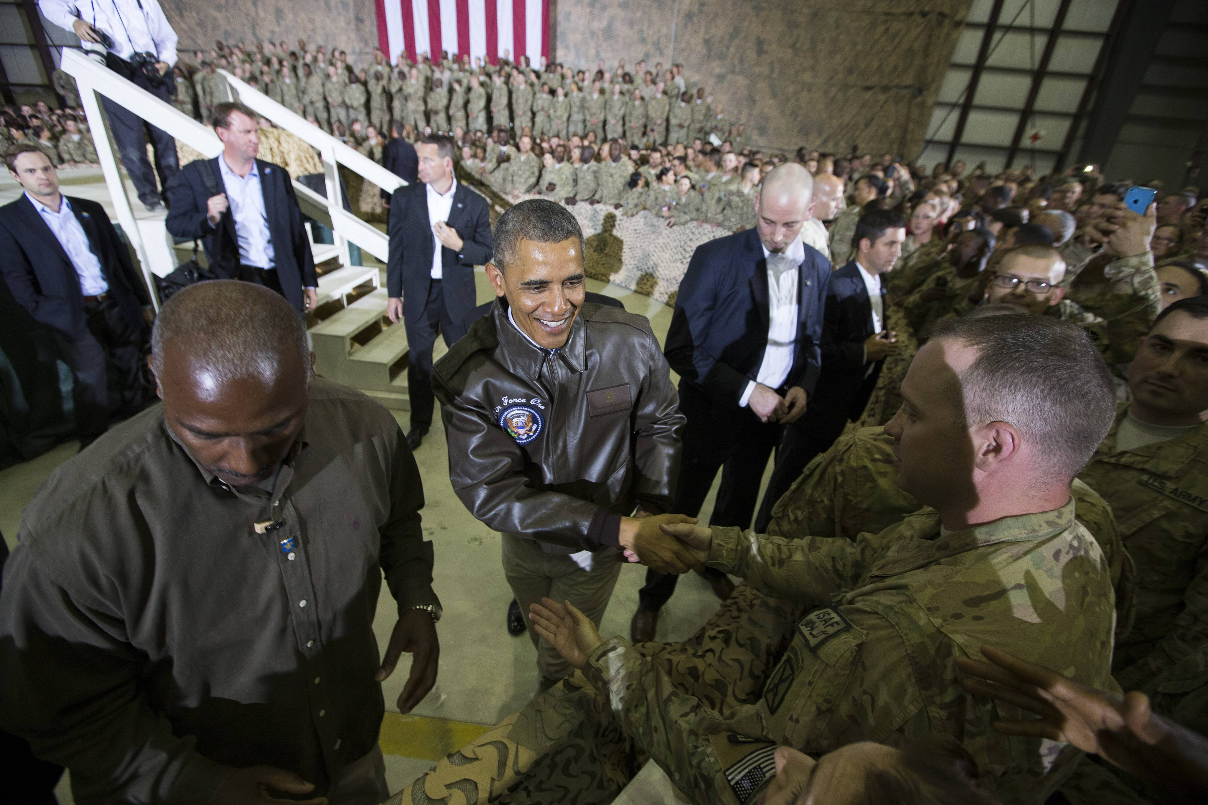 President Barack Obama shakes hands at a troop rally at Bagram Air Field, north of Kabul, Afghanistan.