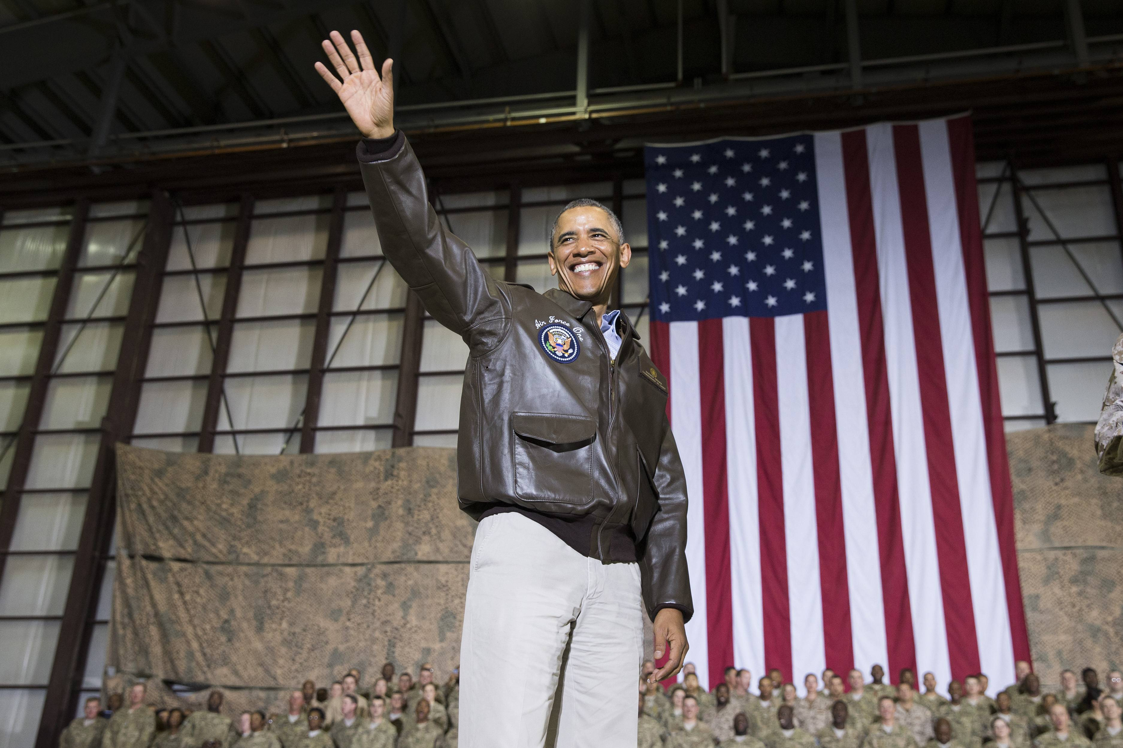 President Barack Obama waves as he arrives for a troop rally after arriving at Bagram Air Field for an unannounced visit.