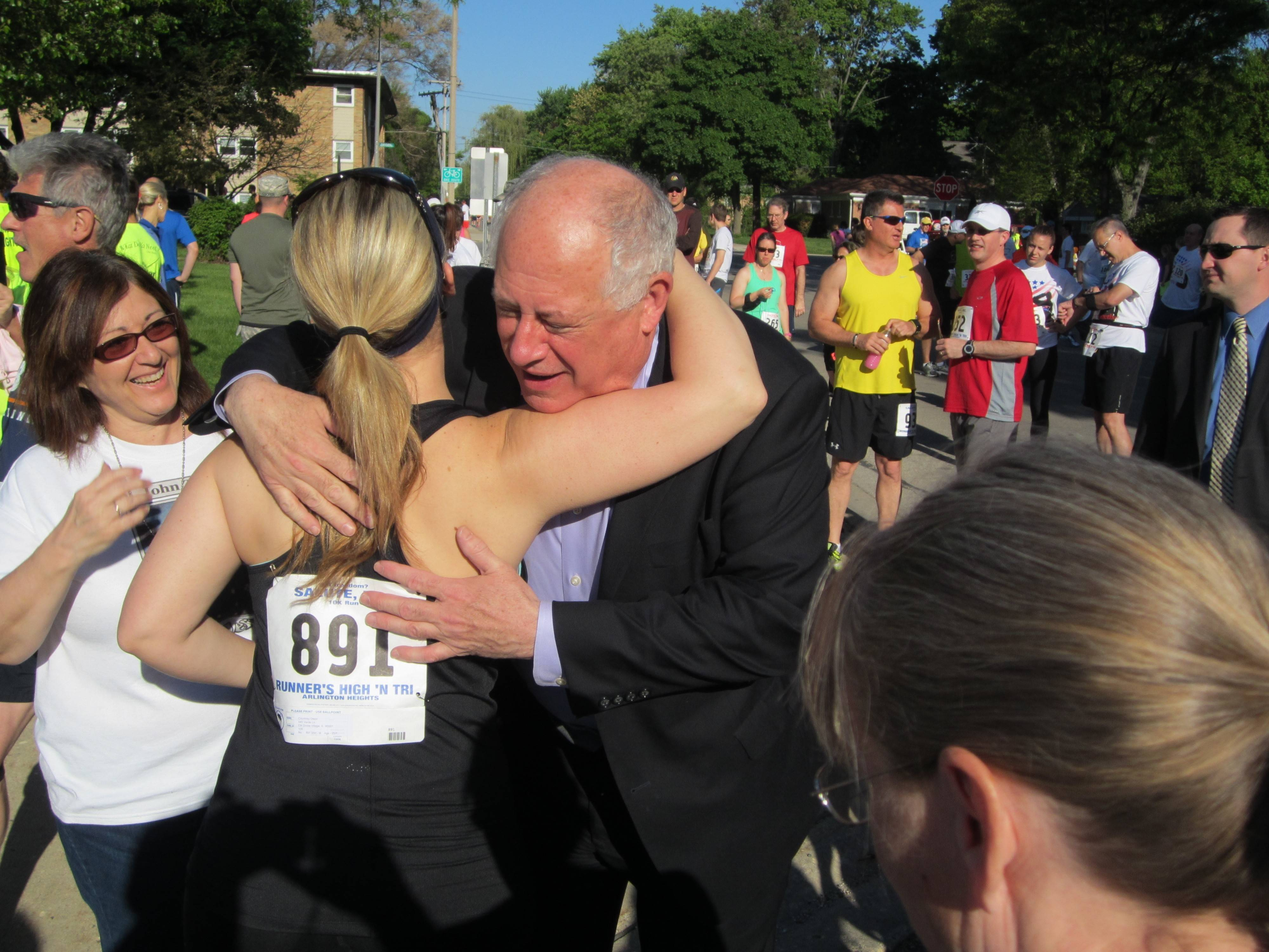 Gov. Pat Quinn hugs an athlete before the start of the 11th annual Salute Inc. Got Freedom? run/walk Sunday in Arlington Heights. The event raises money for military personnel and their families.
