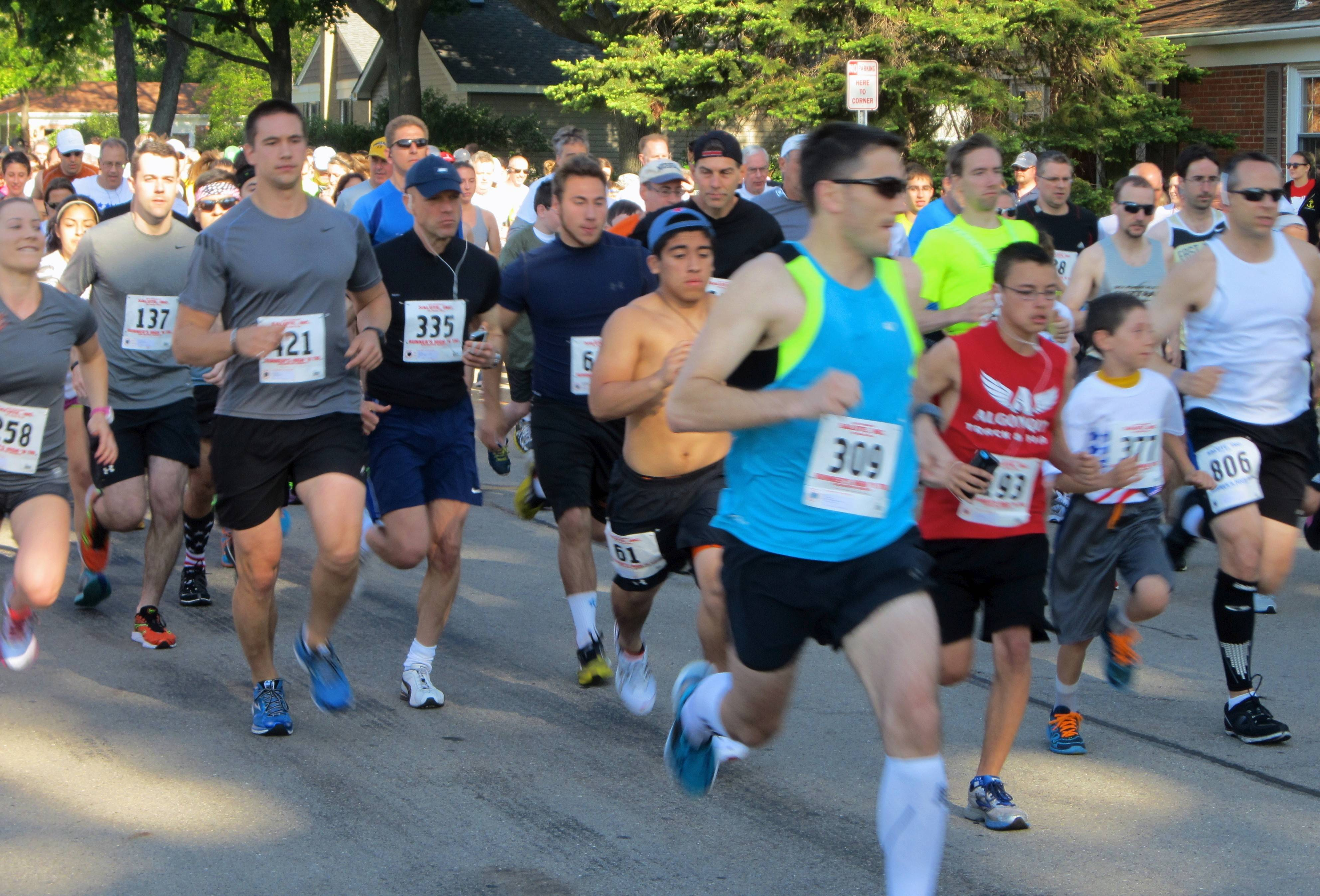 Participants in the 11th annual Salute Inc. Got Freedom? run/walk head down Miner Street Sunday in Arlington Heights.