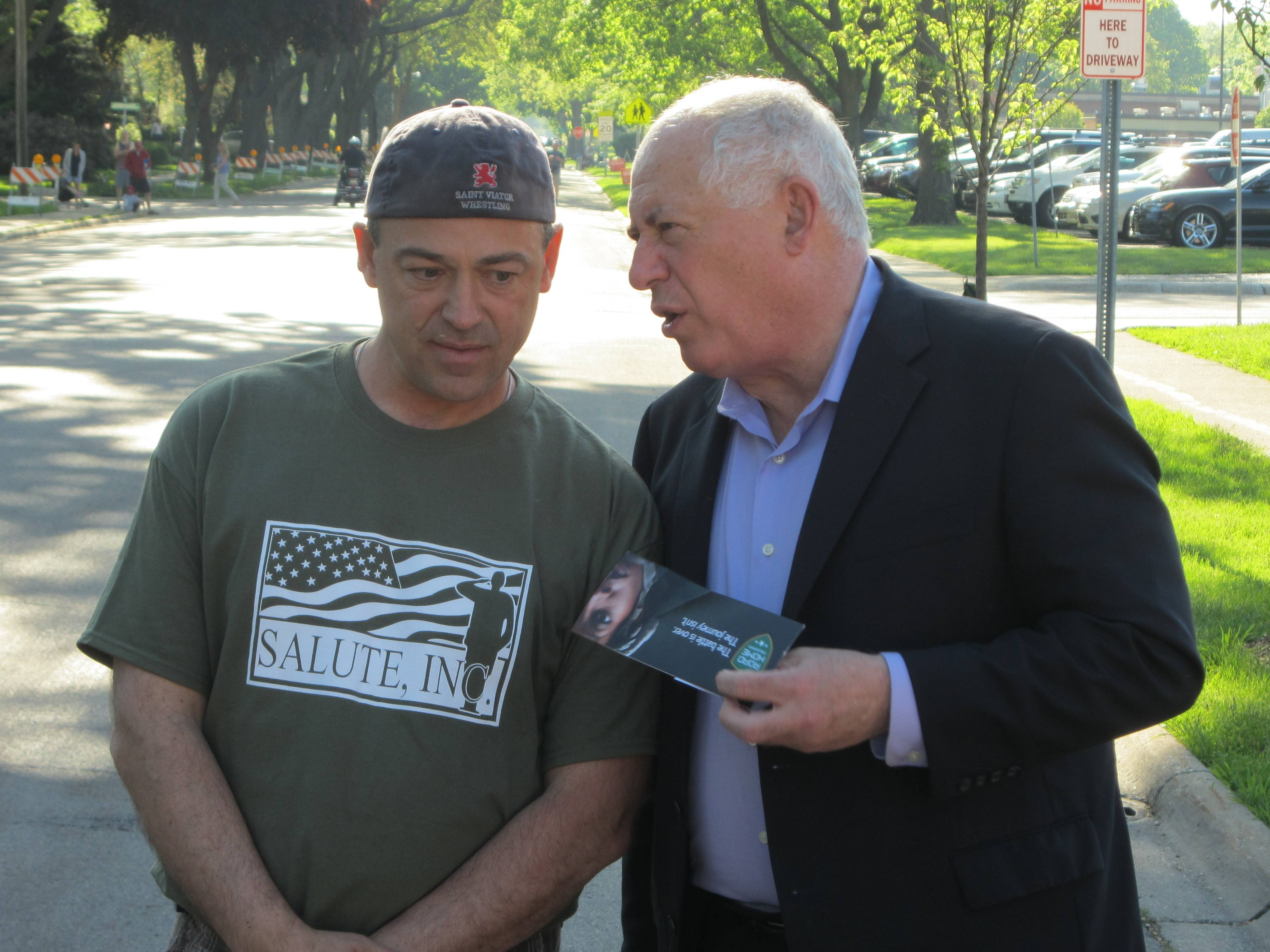 Gov. Pat Quinn, right, talks to Arlington Heights resident Will Beiersdorf, who co-founded Salute Inc. with his wife, Mary Beth. The Beiersdorfs have organized the group's annual Memorial Day weekend run/walk since 2003.