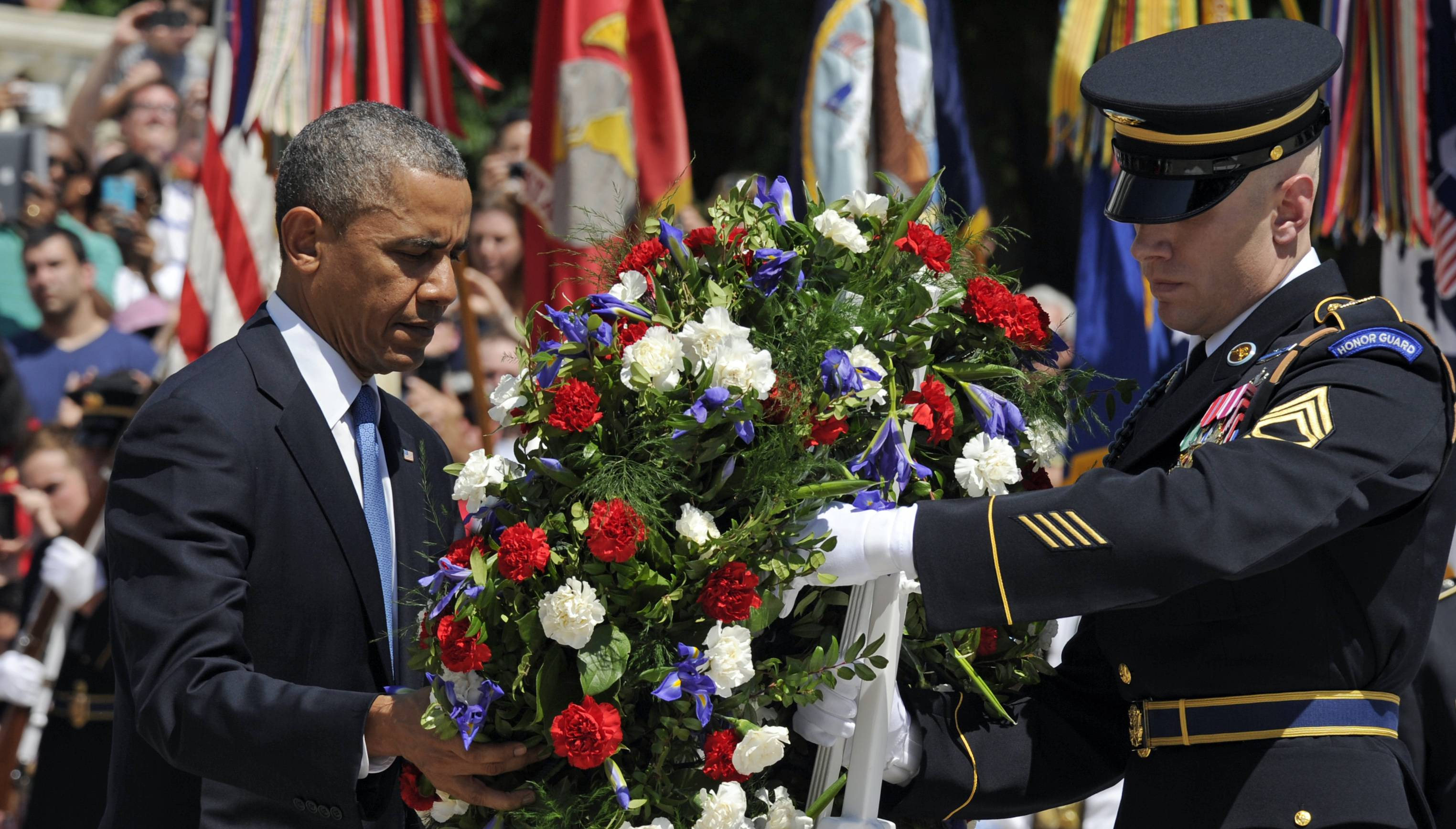 President Barack Obama lays a wreath at the Tomb of the Unknowns at Arlington National Cemetery in Arlington, Va., Monday, May 26, 2014.   President Obama is leading the nation in remembering its war heroes, the fallen and those still defending the flag, in a Memorial Day tribute.