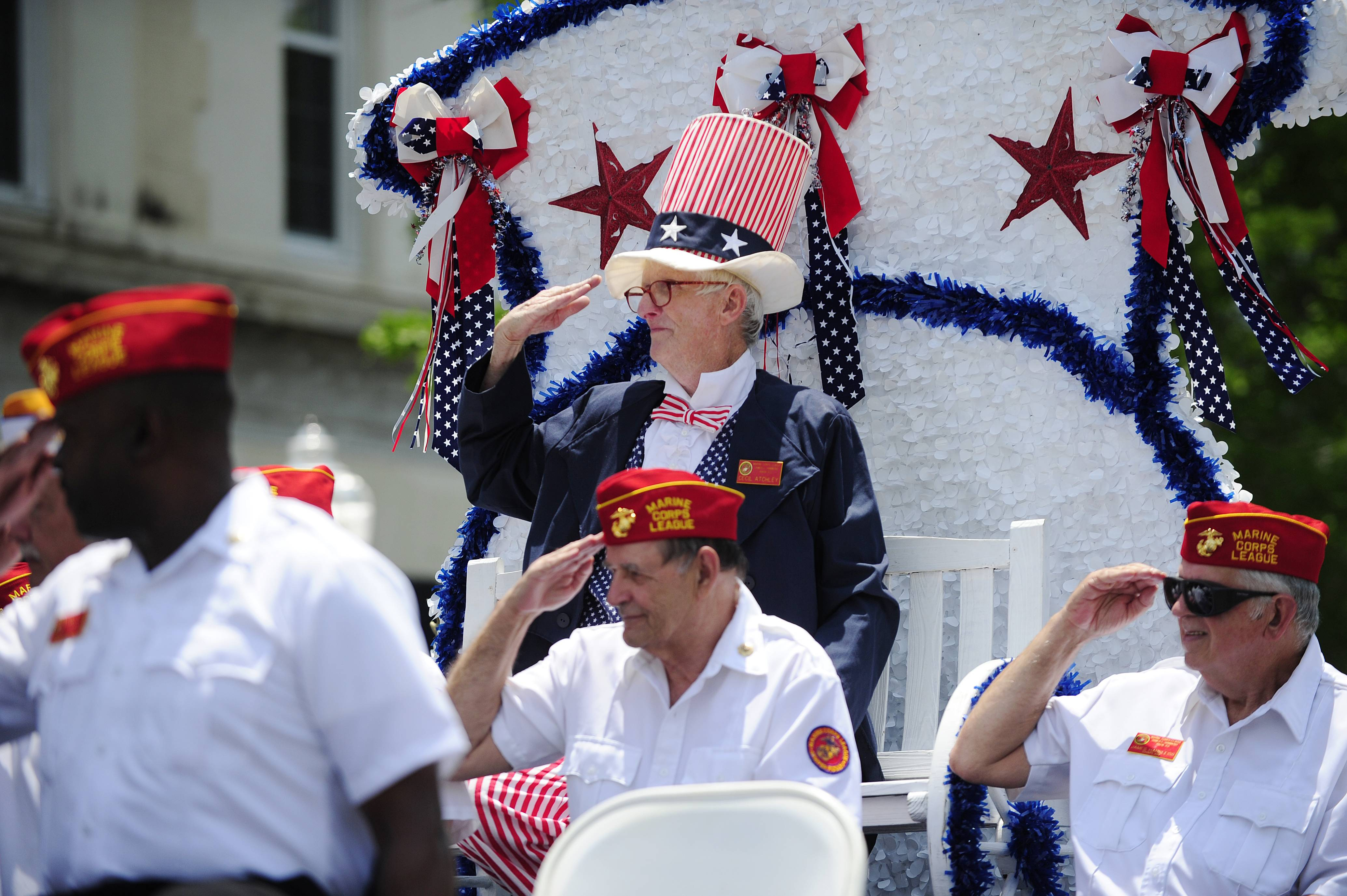 Cecil Atchley waves from the top of the Marine Corps League float during the Memorial Day Parade down Laurens Street on Saturday, May 24, 2014 in downtown Aiken, S.C.