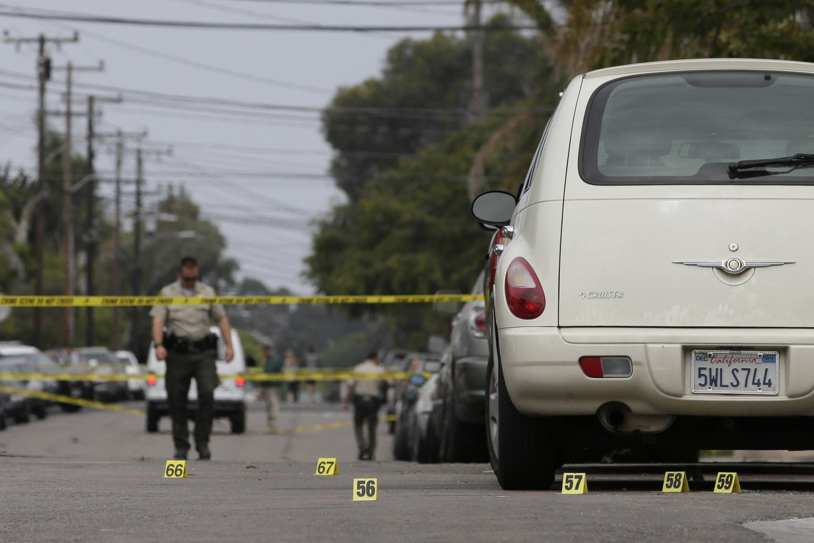 Markers are placed at the scene of a shooting on Saturday, May 24, 2014, in Isla Vista, Calif. A drive-by shooter went on a rampage near a Santa Barbara university campus that left seven people dead, including the attacker, and others wounded, authorities said Saturday.