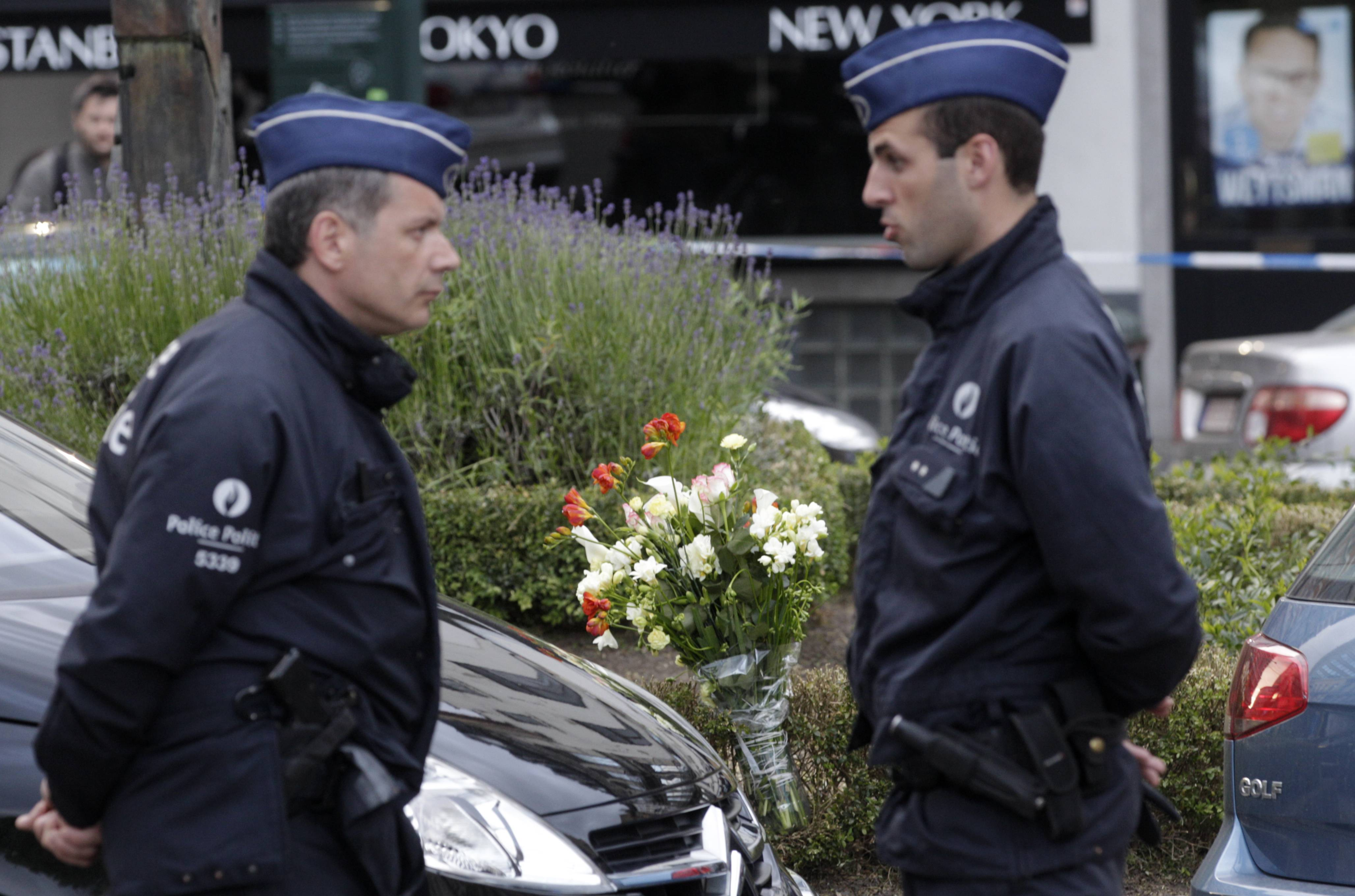 Some flowers were put close to the site of a shooting at the Jewish museum in Brussels, Saturday. Three people were killed and one seriously injured in a spree of gunfire at the Jewish Museum in Brussels on Saturday, officials said. The attack, which came on the eve of national and European Parliament elections, led officials to raise anti-terror measures.