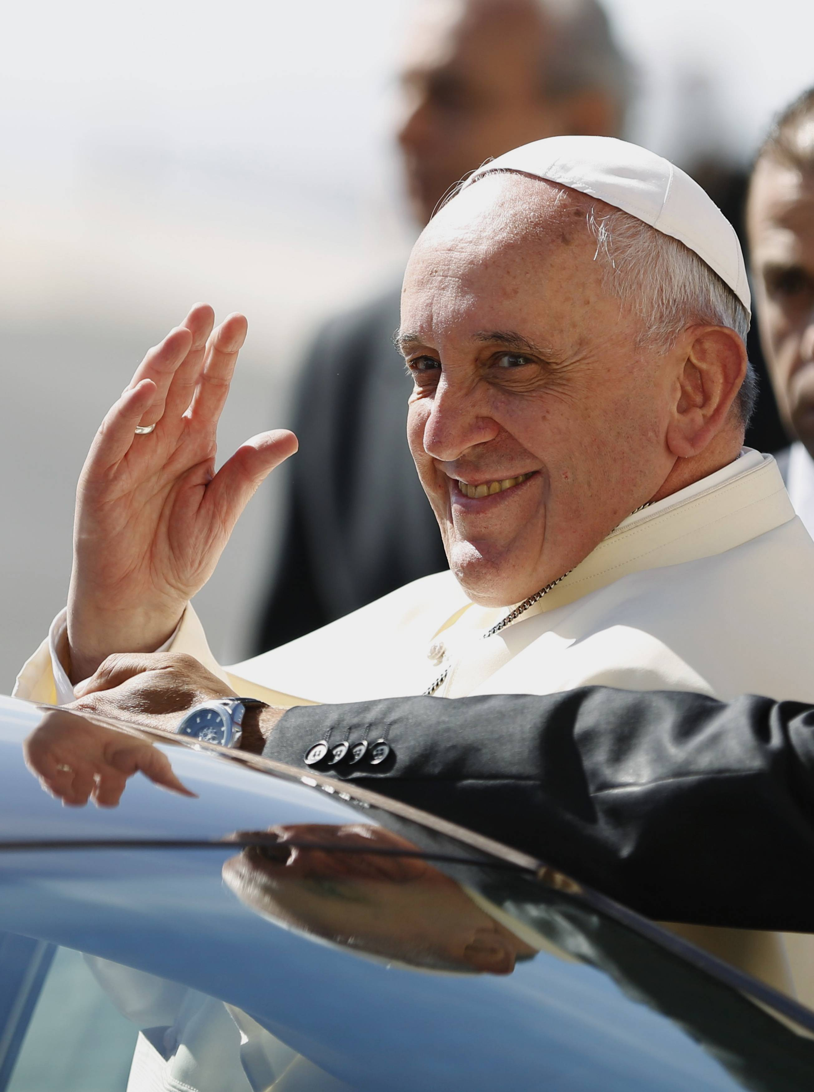 Pope Francis waves upon his arrival at the West Bank town of Bethlehem on Sunday.