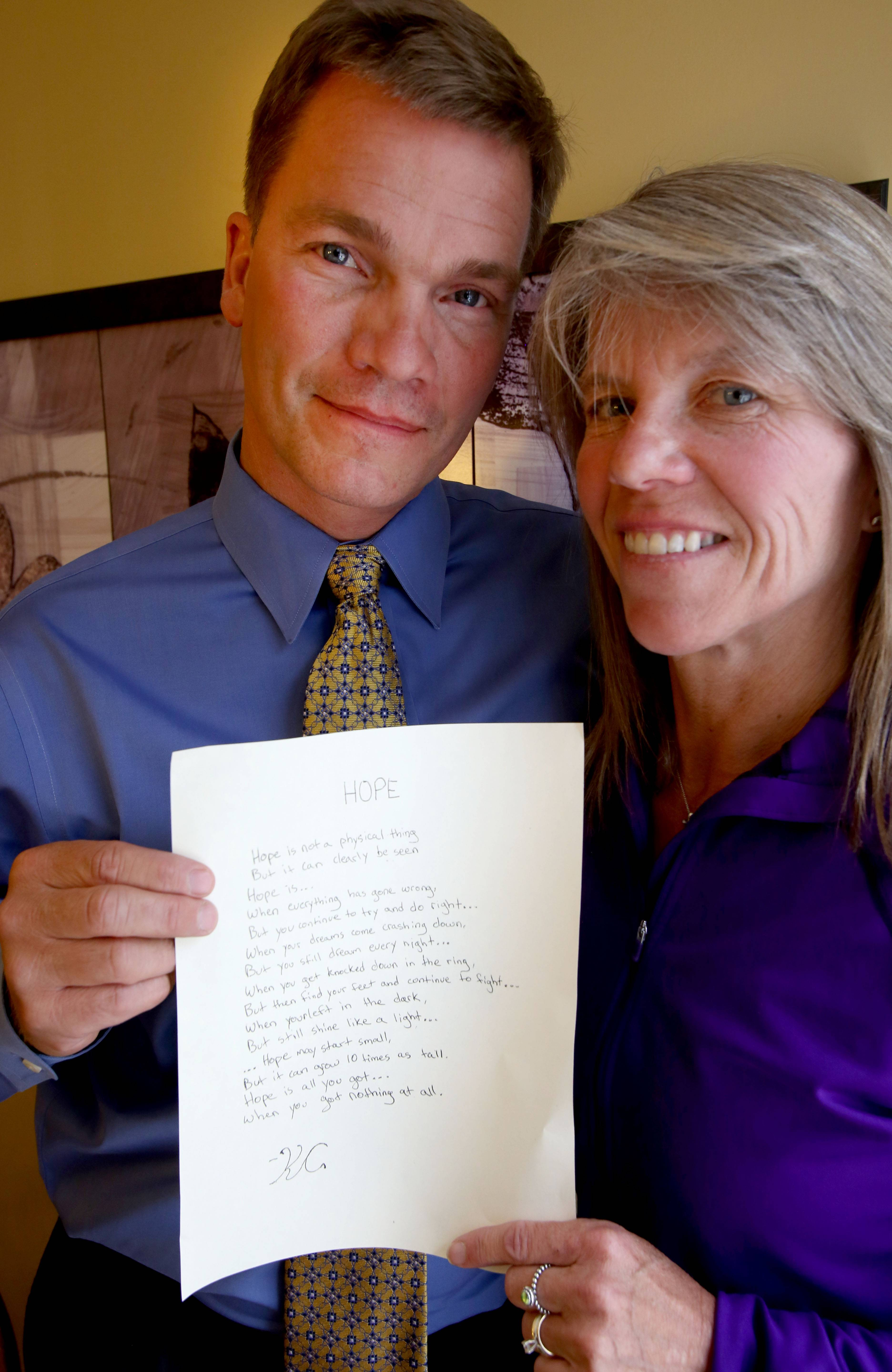 "Joel and Patti Clousing of Wheaton hold a poem called ""Hope"" written by their son Keenan, who died of a heroin overdose on March 1 at age 19."