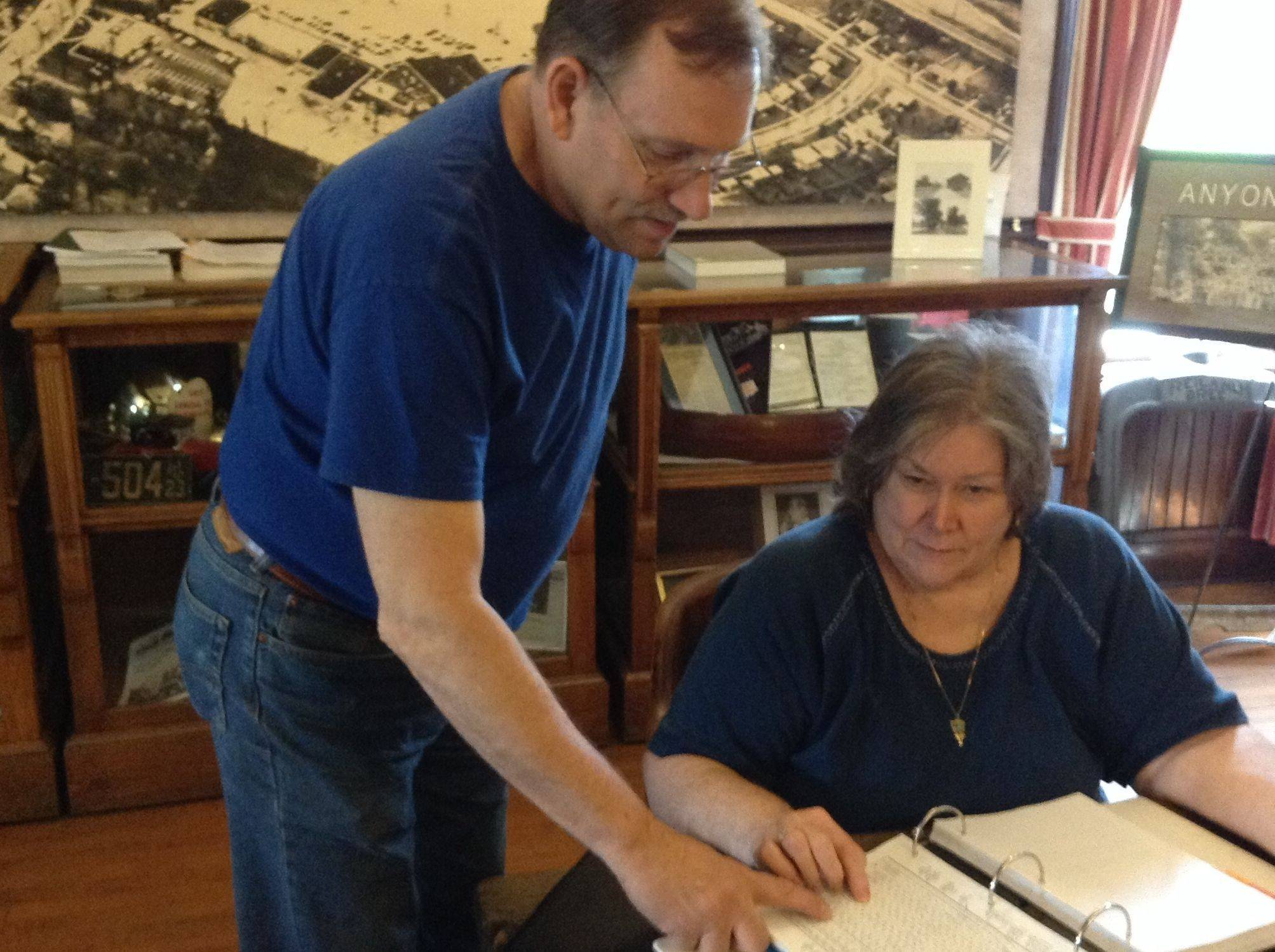 Looking through reams of records at the Northbrook Historical Society, President Judy Hughes and board member Ron Schinleber find information on Schinleber's 19th-century relatives, who were among the first German immigrants to settle in the land that once was home to the Potawatomi tribes.