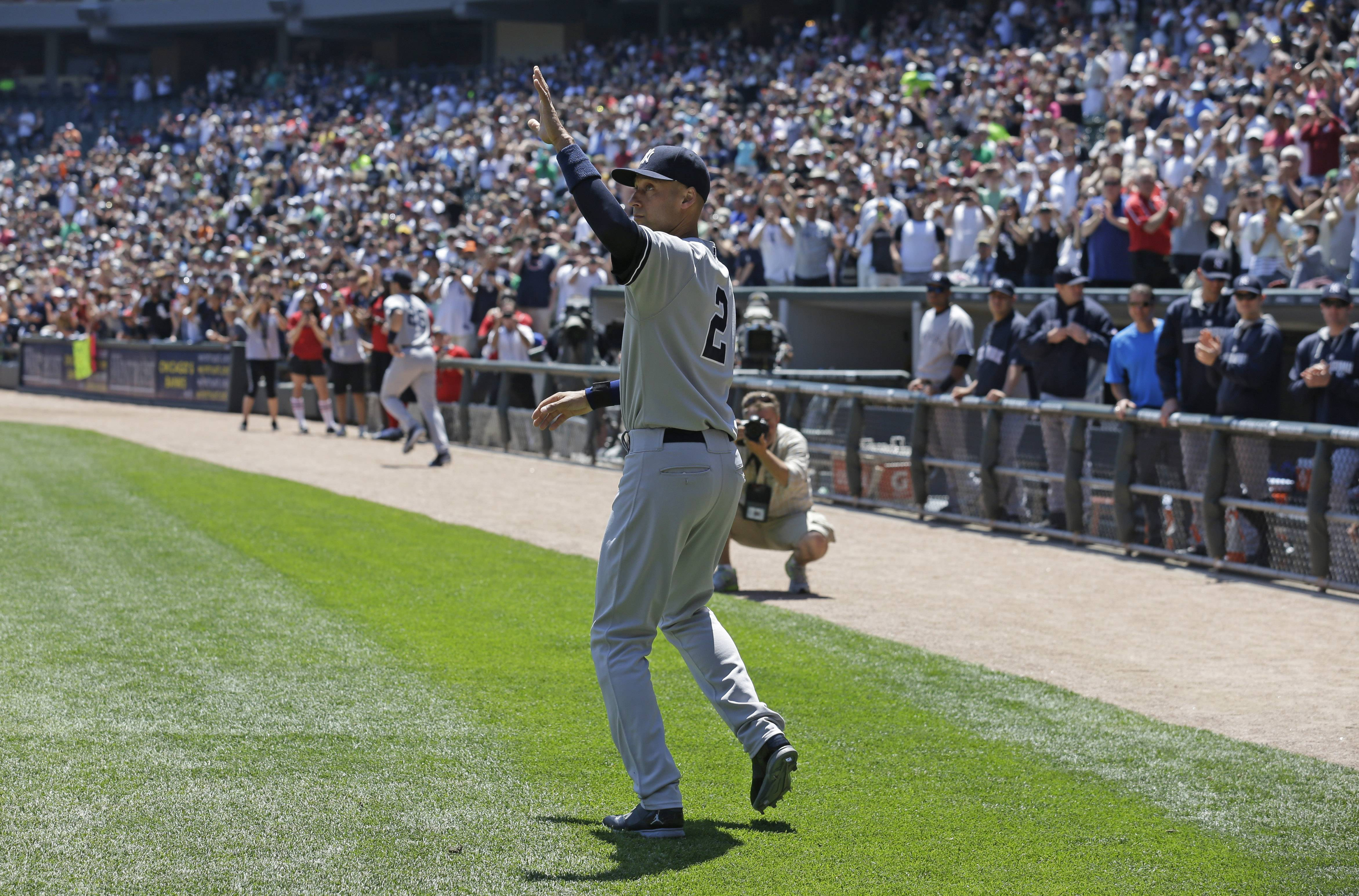 New York Yankees shortstop Derek Jeter waves to the crowd after being presented with gifts from the White Sox Sunday's game at U.S. Cellular Field. Jeter then went out and got 4 hits in the Yankees' 7-1 victory.