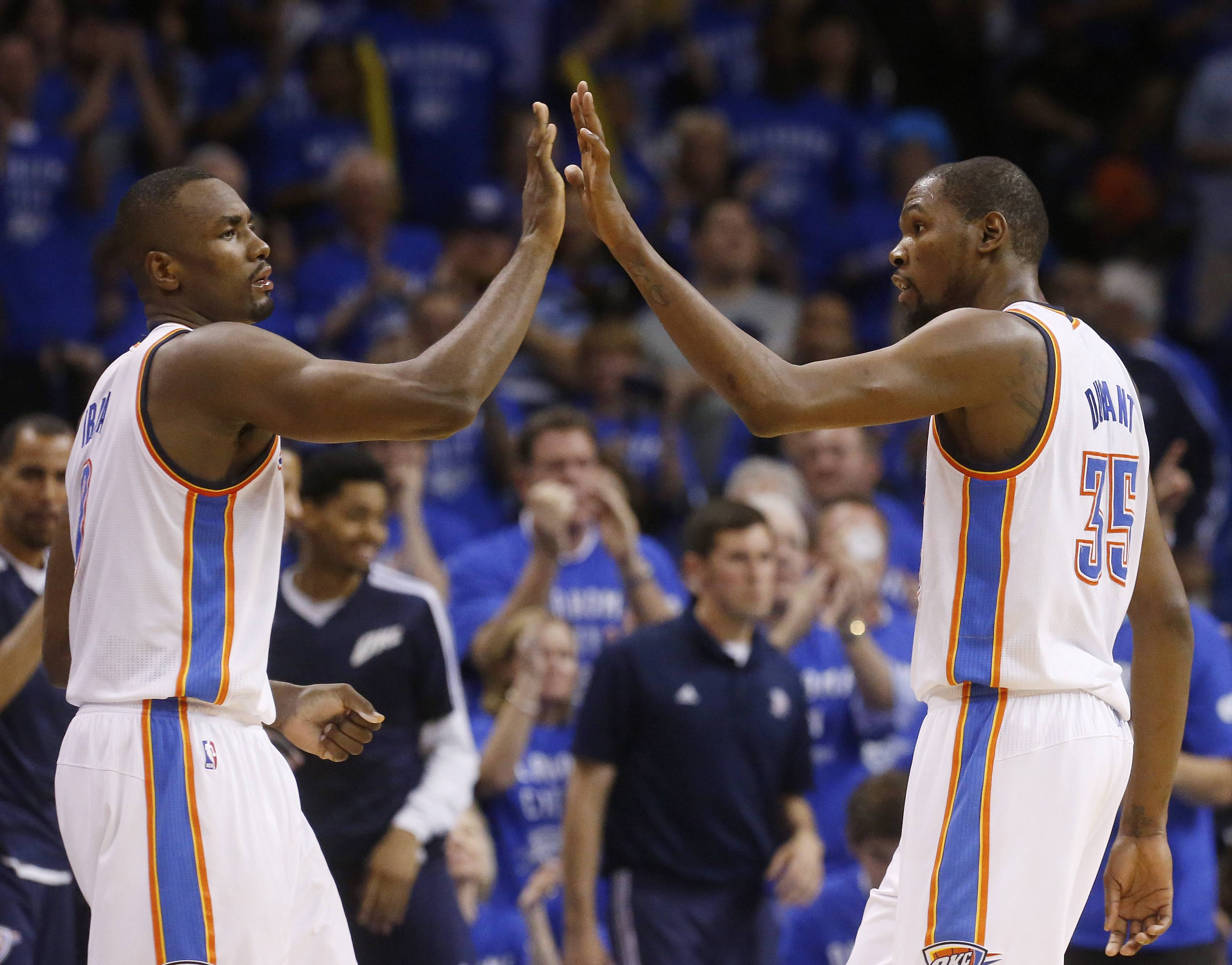 Oklahoma City Thunder forward Serge Ibaka (9) and forward Kevin Durant (35) exchange high-fives in the fourth quarter of Game 3 of an NBA basketball playoff series in the Western Conference finals against the San Antonio Spurs, Sunday, May 25, 2014, in Oklahoma City. Oklahoma City won 106-97. Durant scored 25 points and 10 rebounds. Ibaka had 15 points.