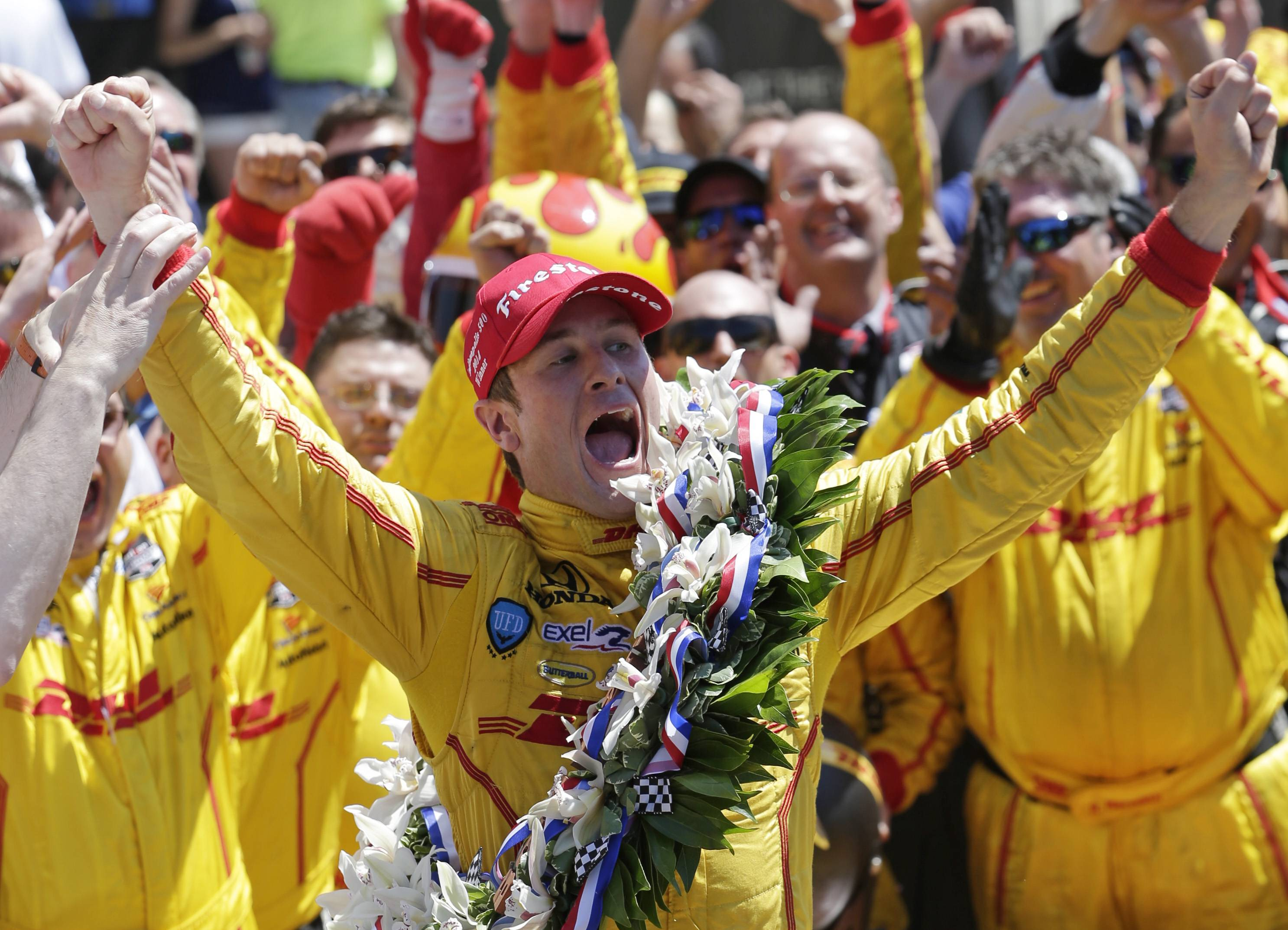 Ryan Hunter-Reay celebrates winning the 98th running of the Indianapolis 500 IndyCar auto race.