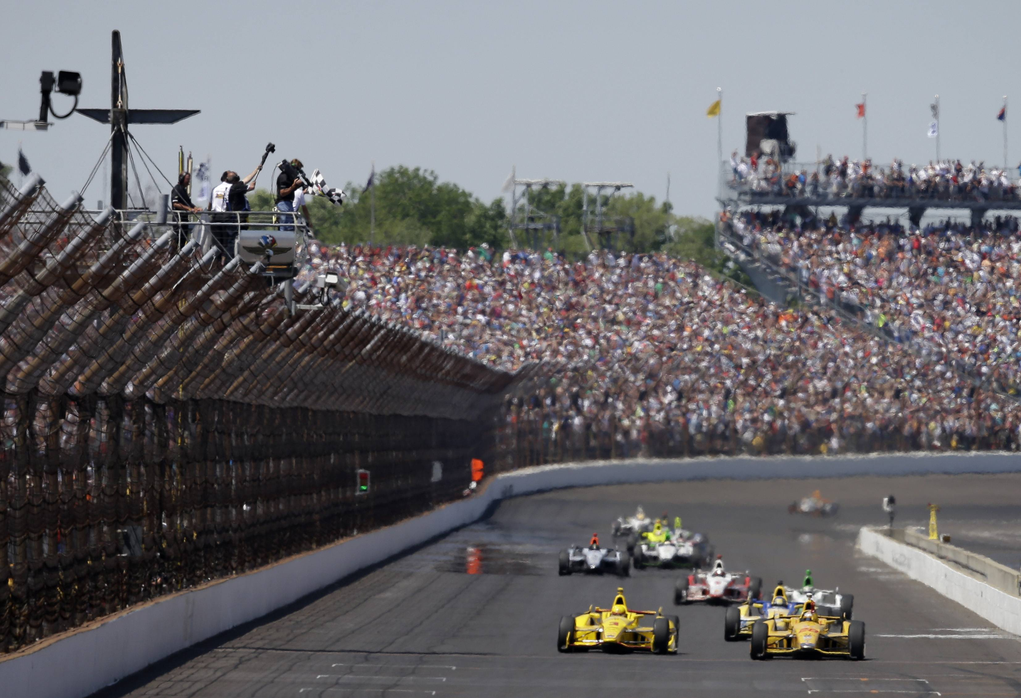 Ryan Hunter-Reay celebrates as he takes the checkered flag to win the 98th running of the Indianapolis 500 IndyCar auto race at the Indianapolis Motor Speedway in Indianapolis, Sunday.