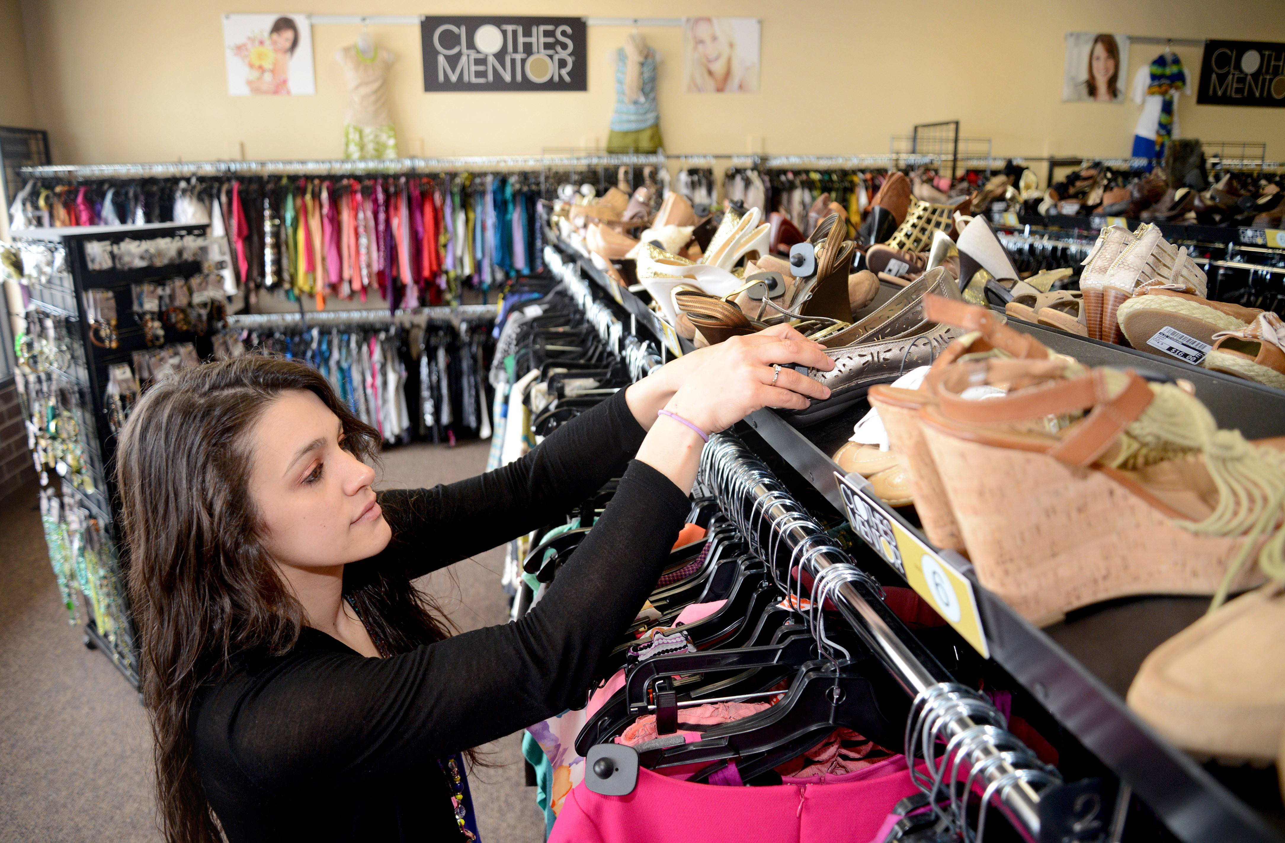 Assistant Manager Myriah Rogers straightens shoes at Clothes Mentor at 79 S. Randall Road in Batavia. The franchise store is an upscale used clothing resale shop. It buys gently used clothing, shoes and jewelry for cash. Another location in Algonquin will open at the end of June.