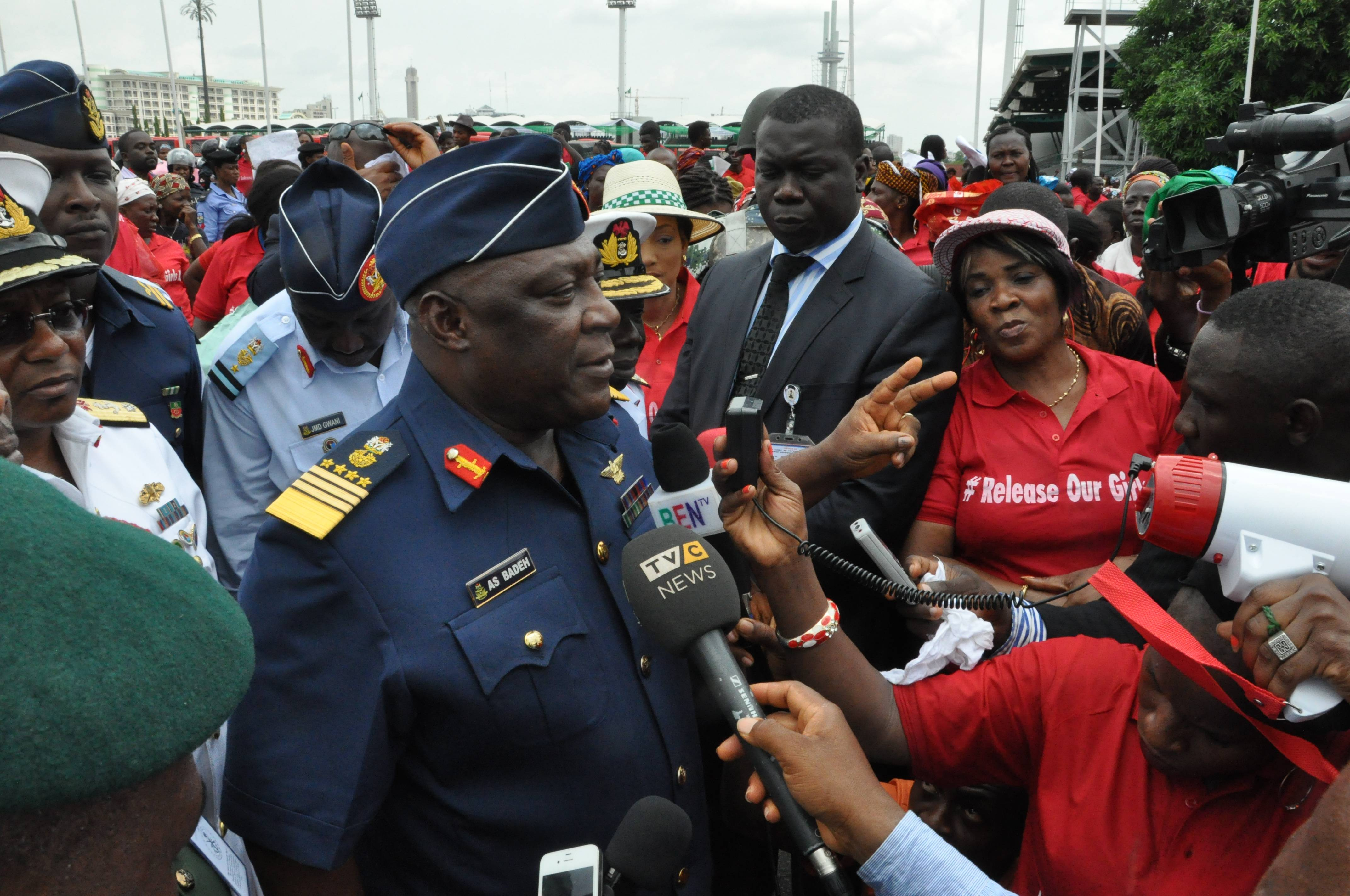 "Nigeria's chief of defense staff Air Marshal Alex S. Badeh, centre, speaks Monday during a demonstration calling on the government to rescue the kidnapped girls of the government secondary school in Chibok, in Abuja, Nigeria. Scores of protesters chanting ""Bring Back Our Girls"" marched in the Nigerian capital Monday to protest the abductions of more than 300 schoolgirls by Boko Haram, the government's failure to rescue them and the killings of scores of teachers by Islamic extremists in recent years."