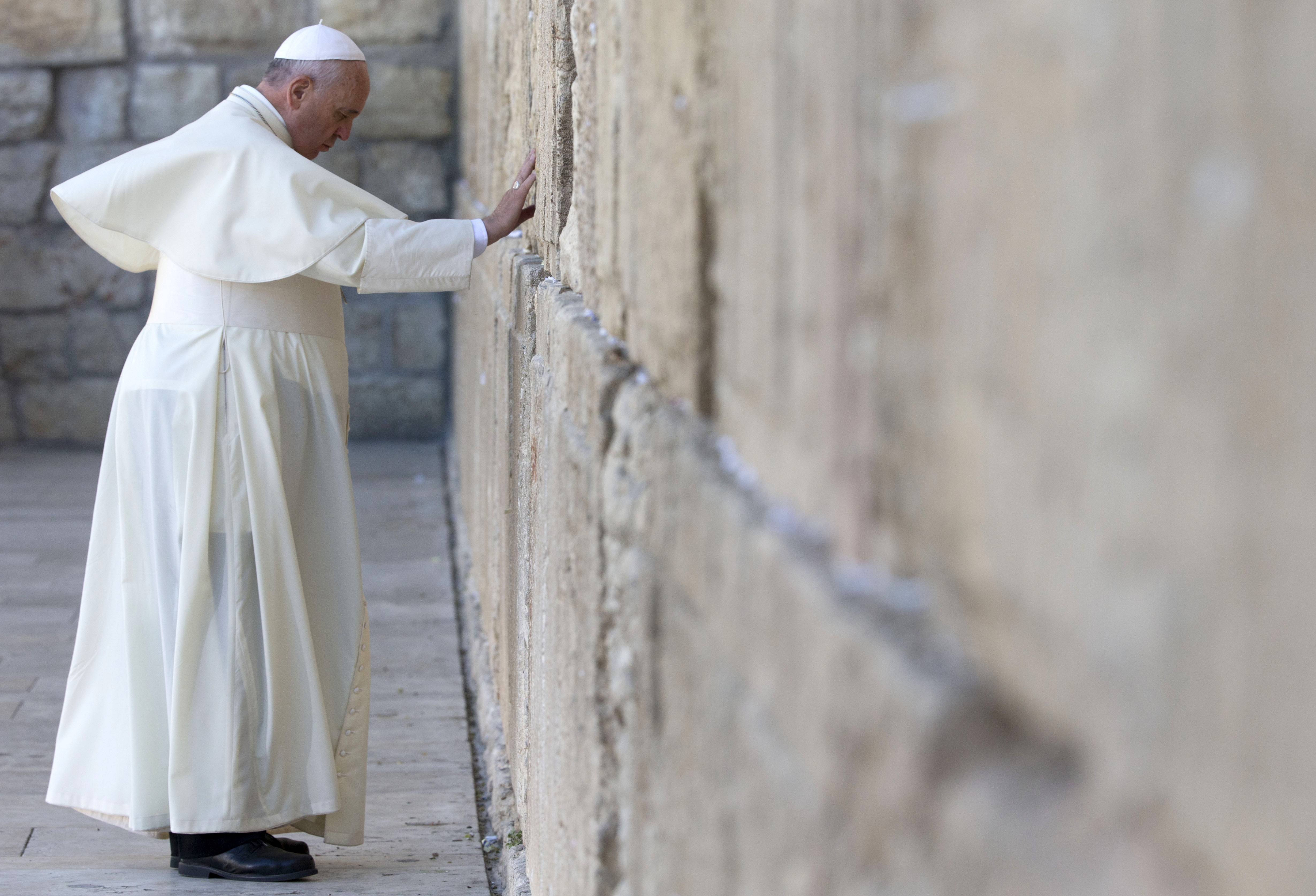Pope Francis prays at the Western Wall, the holiest place where Jews can pray, in the old city of Jerusalem, Israel, Monday, May 26, 2014.