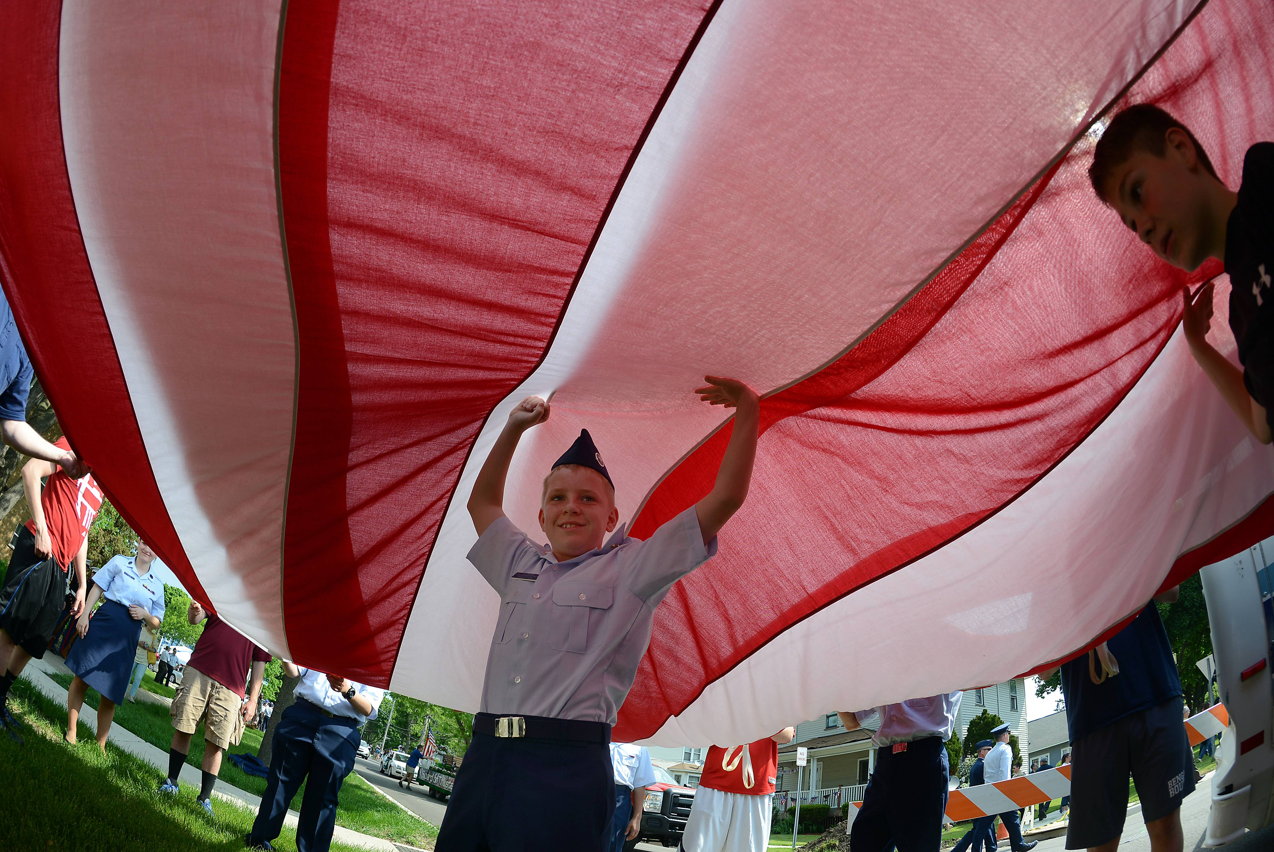 Cadet Basic of the Civil Air Patrol of Lake in the Hills Jacob Skrzypinski, 13, of West Dundee holds up the center of the giant flag at the Arlington Heights Memorial Day parade and ceremony on Monday.