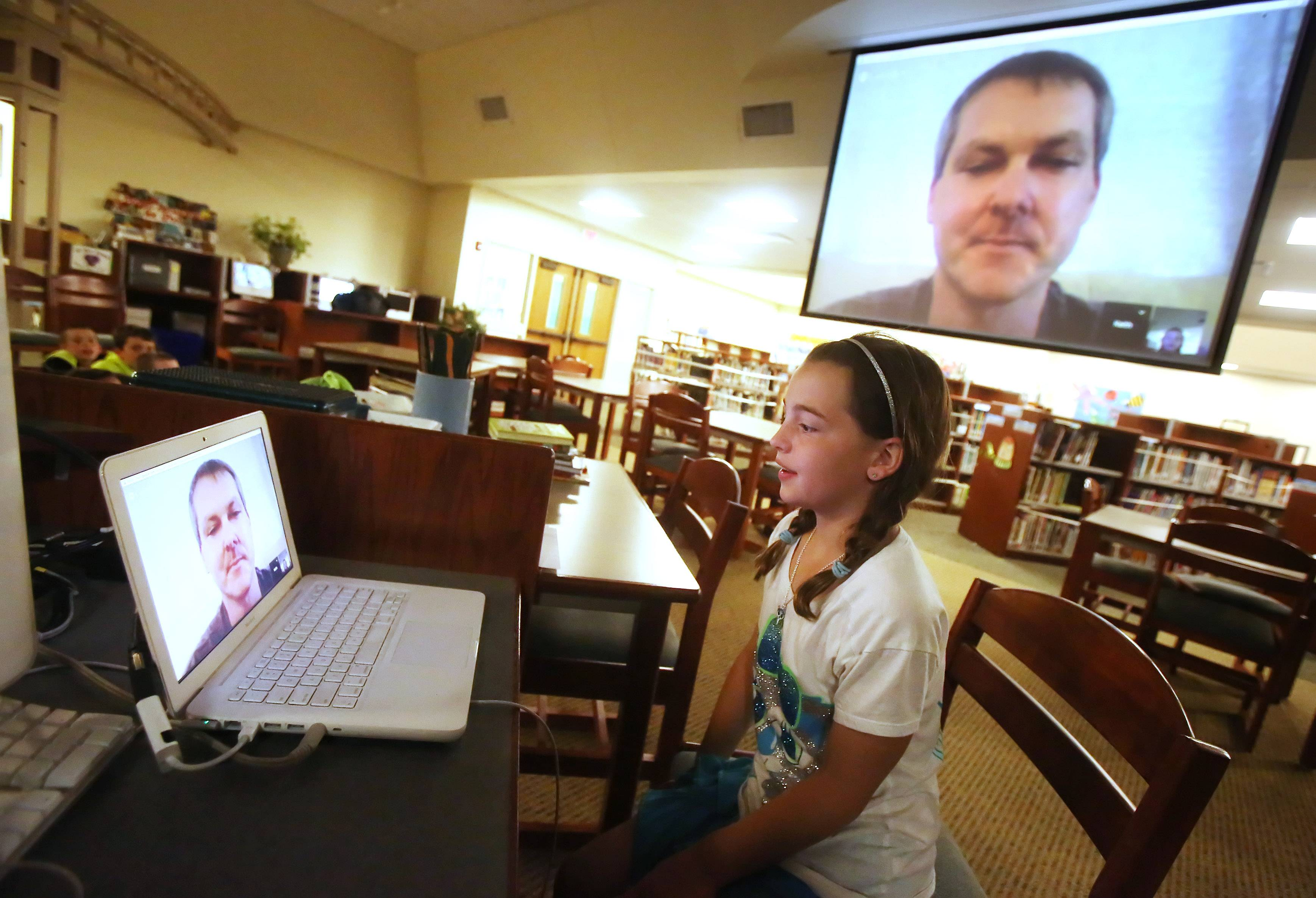 Fourth grader Maddie Rupert asks a question during a video chat with marine biologist Keith Fischer Monday in the learning center at Butterfield School in Libertyville. The students are studying ecosystems and talked with Fischer, who works with the Fish and Wildlife Institute in St. Petersburg, Florida.