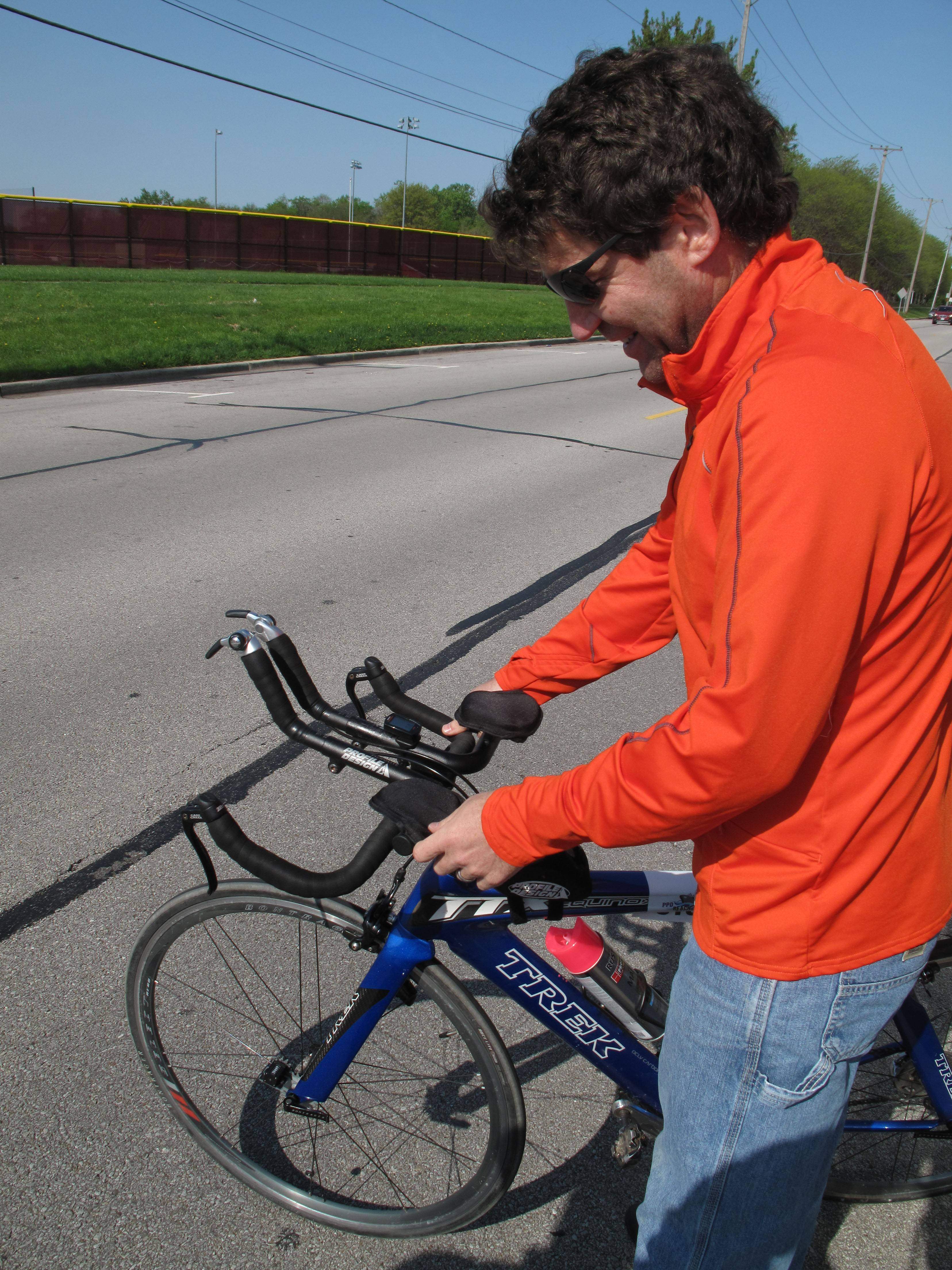Craig Bixler, one of the race directors for the Edward Hospital Naperville Marathon, studies a device called a Jones Counter attached to his bicycle to measure and certify the course for the second annual race.