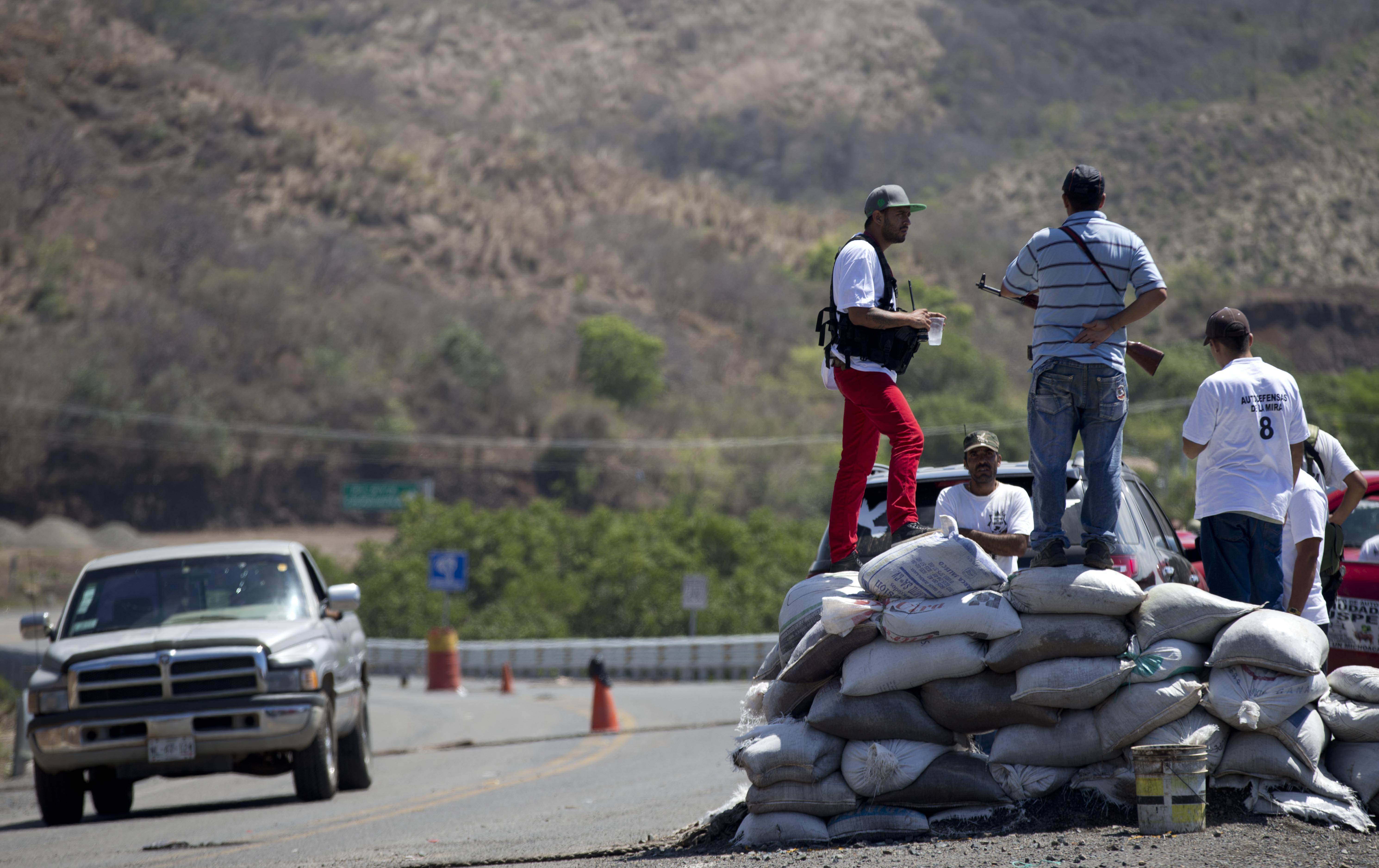 Armed men belonging to the Self-Defense Council of Michoacan, (CAM), stand guard at a checkpoint set up by the vigilantes in Chuquiapan, on the outskirts of the seaport of Lazaro Cardenas, in western Mexico. Mexico was once the top location for U.S. students studying in Latin America, with so many economic and familial ties between the two neighbors. But the numbers dropped with the spike in drug violence.