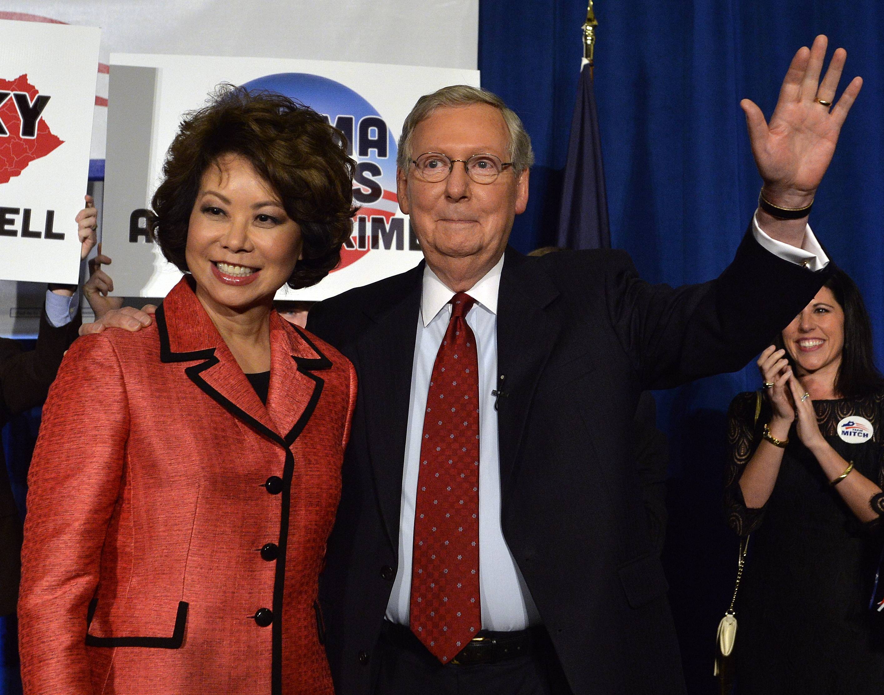 Kentucky Senator Mitch McConnell, right, and his wife Elaine Chao wave to his supporters following his victory in the republican primary Tuesday, May 20, McConnell, R-Ky., is nobody's example of a tea party Republican.