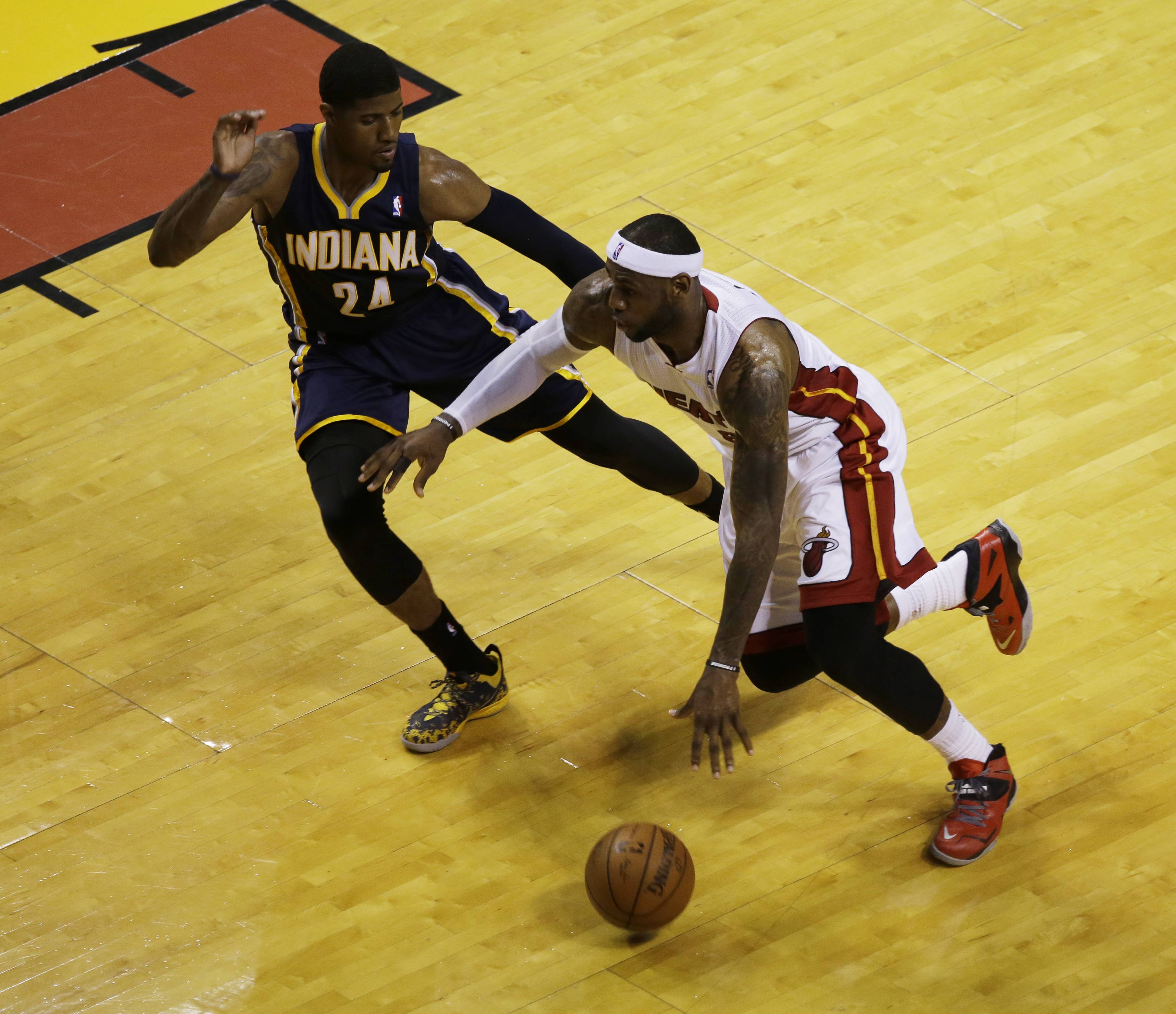 Miami Heat forward LeBron James (6) dribbles pass Indiana Pacers forward Paul George (24) during Game 4 in the NBA basketball Eastern Conference finals playoff series, Monday, May 26, 2014, in Miami. The Heat won 102-90.