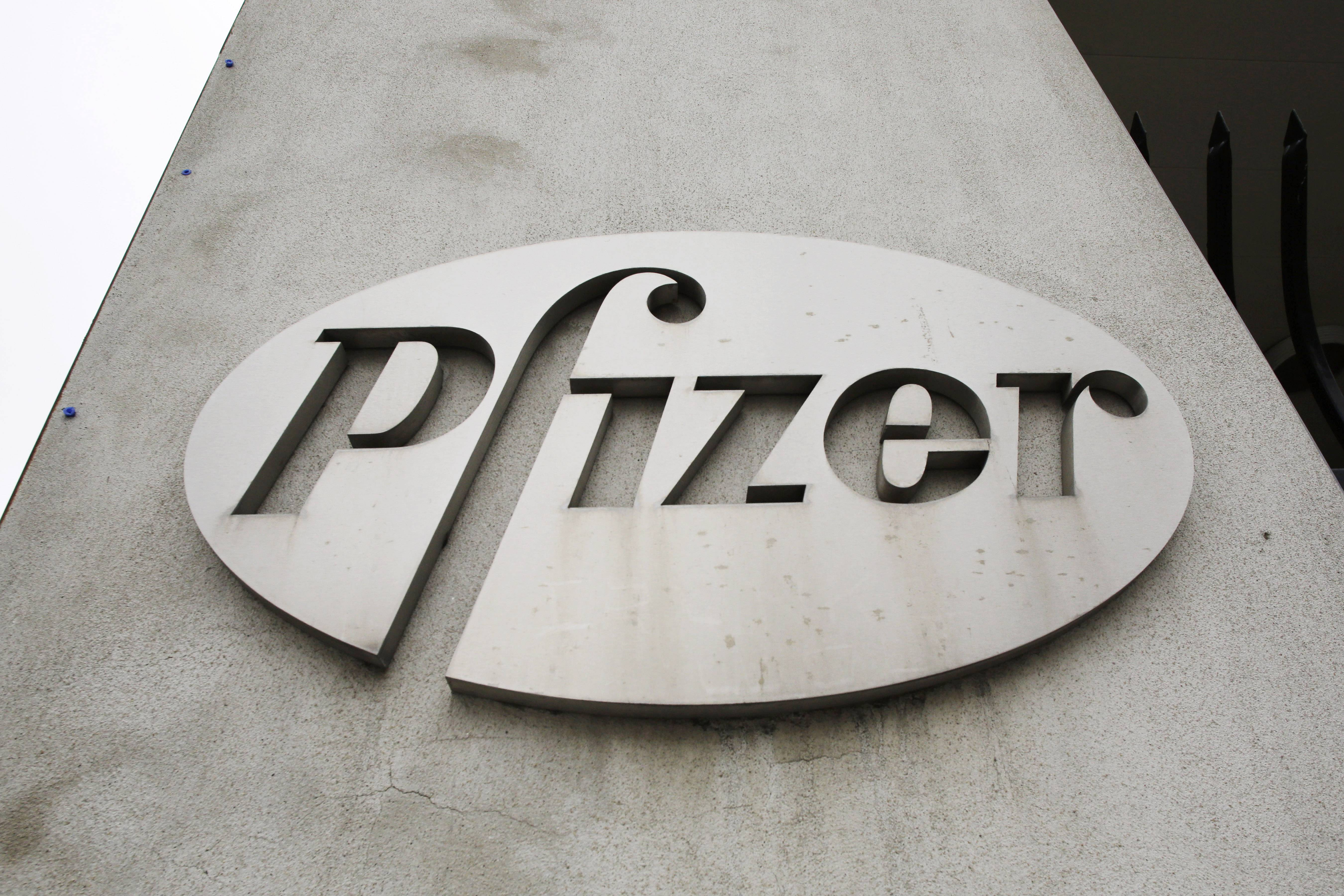 In this May 4, 2014 photo, the Pfizer logo is displayed on the exterior of a former Pfizer factory in the Brooklyn borough of New York. Pfizer says it does not intend to make a takeover offer for British drugmaker AstraZeneca. The Monday, May 26, 2014 announcement comes a week after AstraZeneca's board rejected a proposed $119 billion buyout offer from Pfizer, the world's second-biggest drugmaker by revenue.