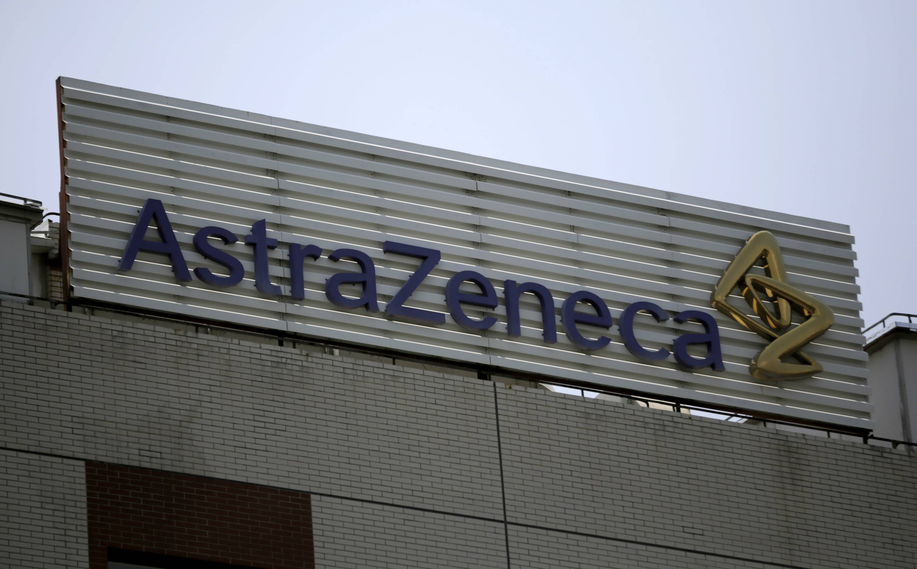 This July 24, 2013 file photo shows the AstraZeneca logo on the company's building in Shanghai, China. Pfizer says it does not intend to make a takeover offer for British drugmaker AstraZeneca. The Monday, May 26, 2014 announcement comes a week after AstraZeneca's board rejected a proposed $119 billion buyout offer from Pfizer, the world's second-biggest drugmaker by revenue.