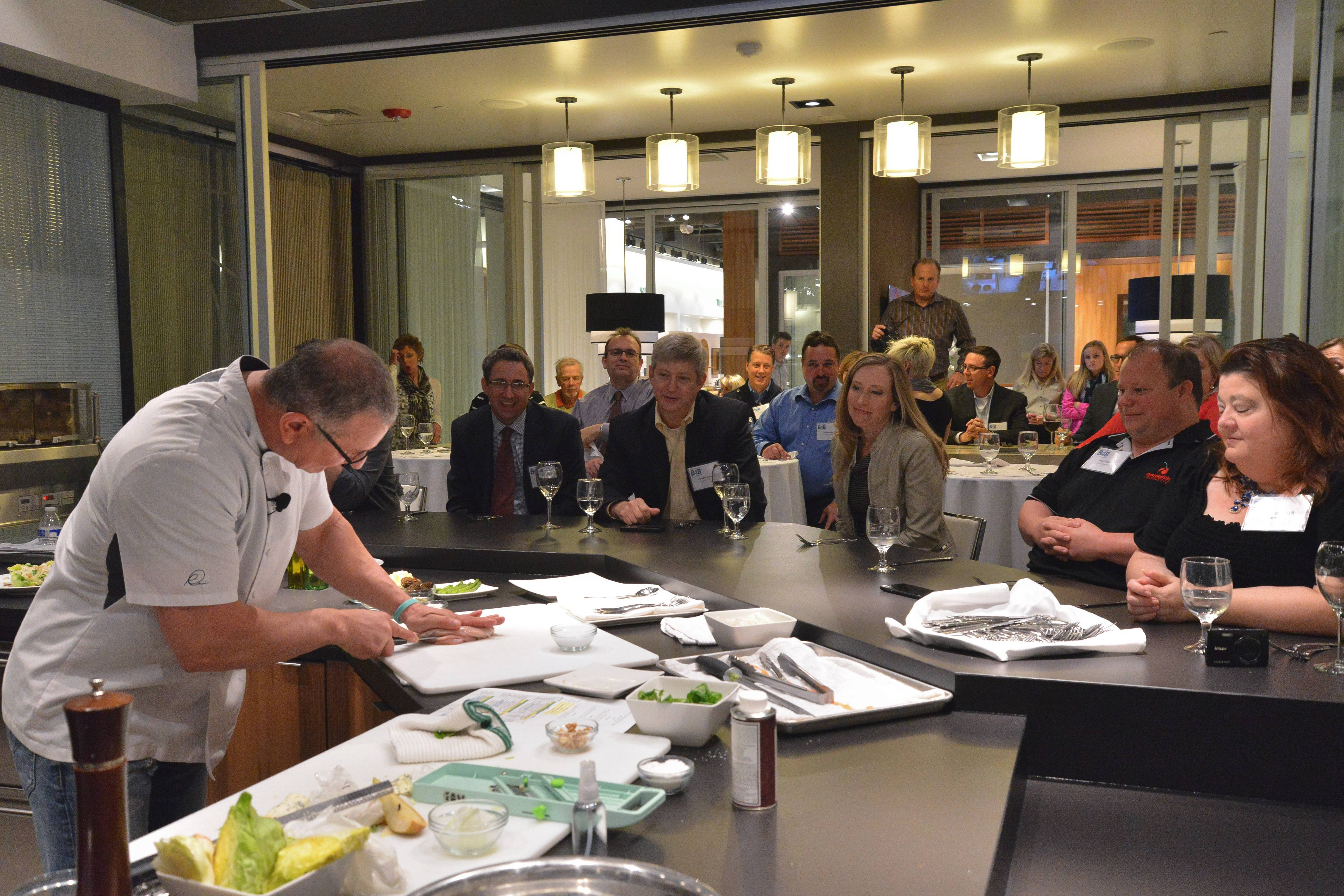"Food Network star and ""Restaurant: Impossible"" host Robert Irvine stopped by the Comcast offices in Naperville and offered a private demo at Pirch restaurant in Oak Brook Center."