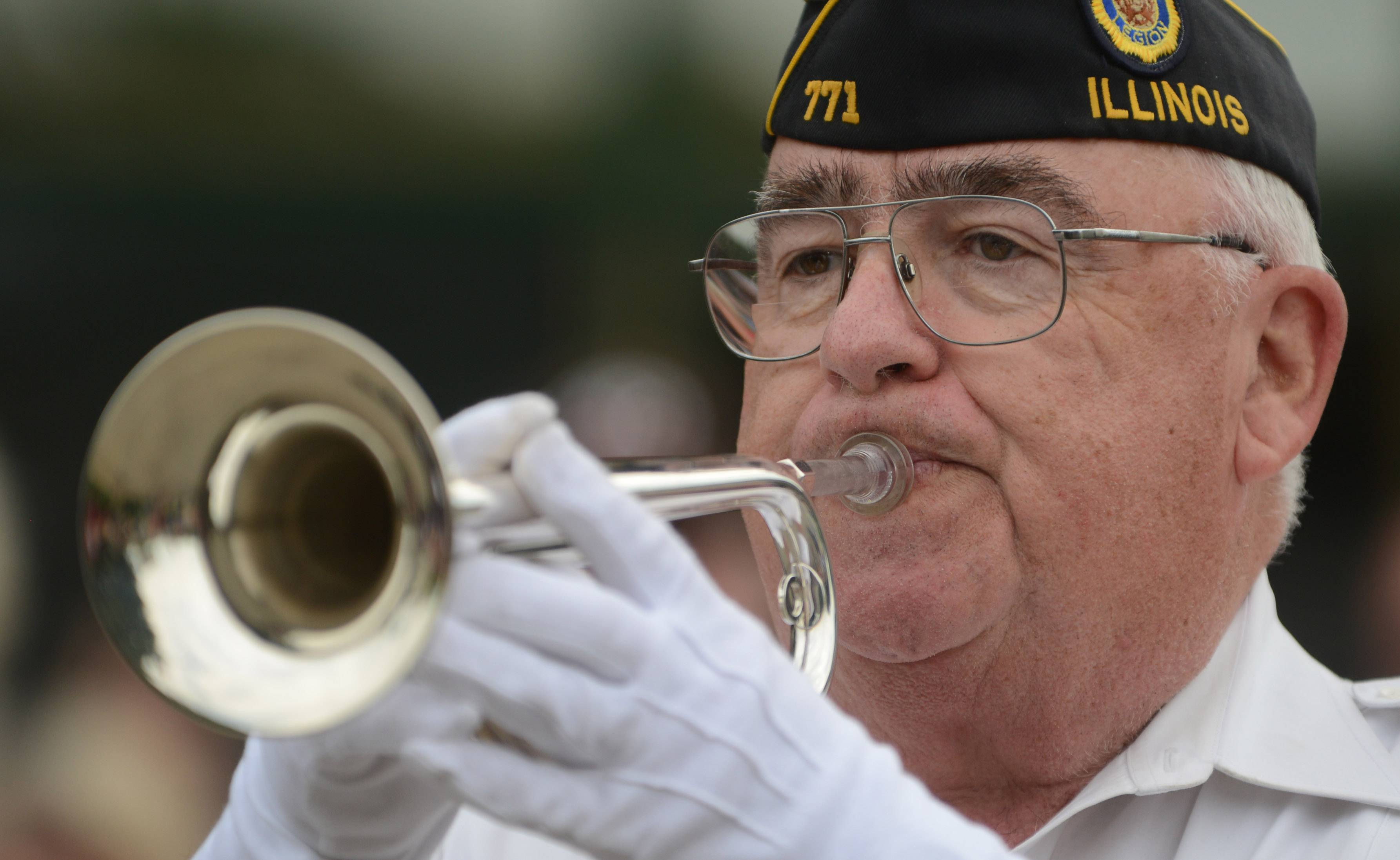 Jim Reynolds of Round Lake Park plays taps during the Fox Lake Memorial Day ceremony Monday.