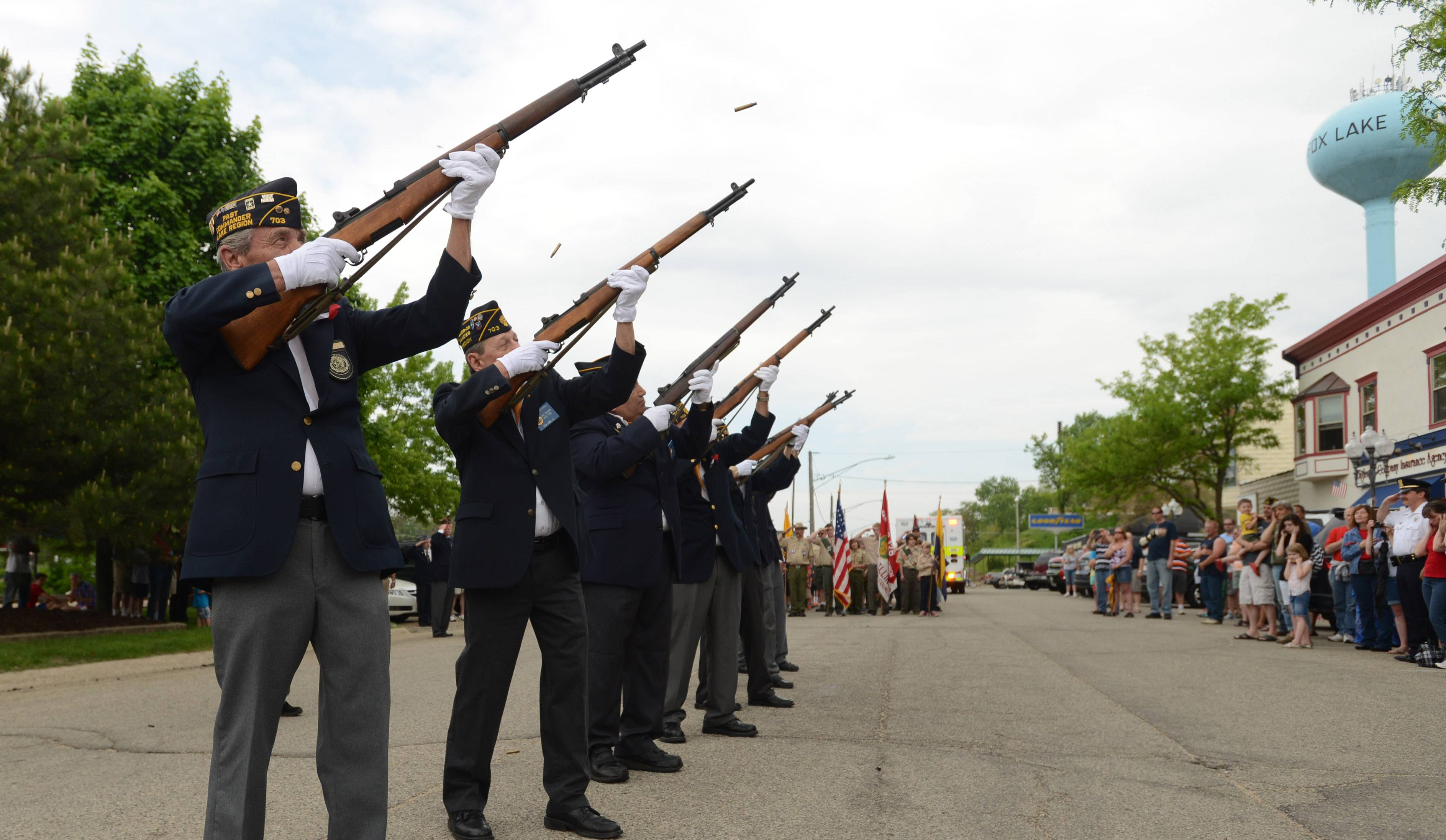 The rifle squad fires during the Fox Lake Memorial Day ceremony in the downtown.