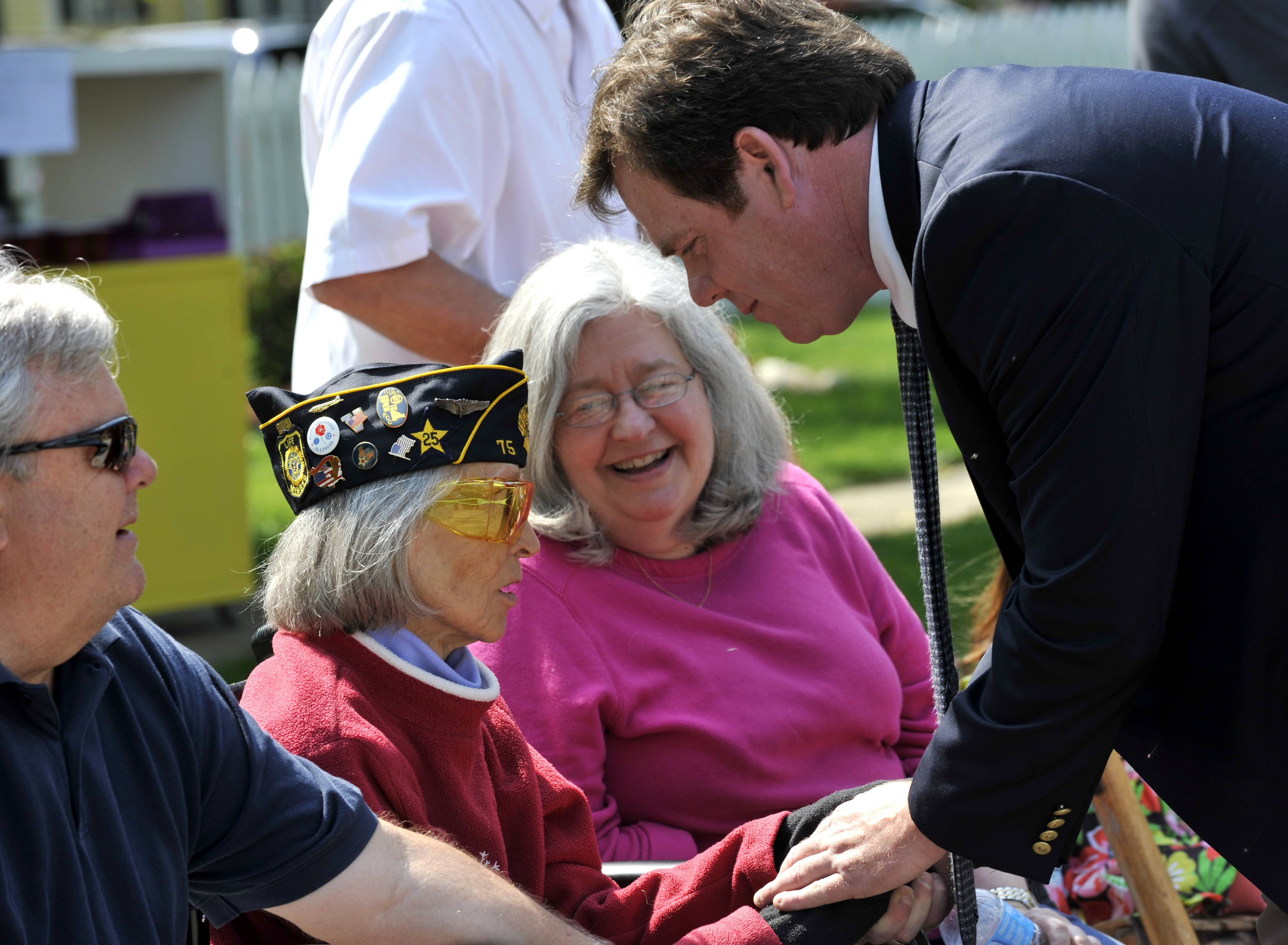 Geneva Mayor Kevin Burns greets Susanna Haroldson, 94, of Geneva at the Geneva Memorial Day parade on Third Street. A World War II veteran, Haroldson served as a flight nurse. She sits with her son Craig Haroldson and daughter-in-law Maggie Haroldson, both of Geneva.