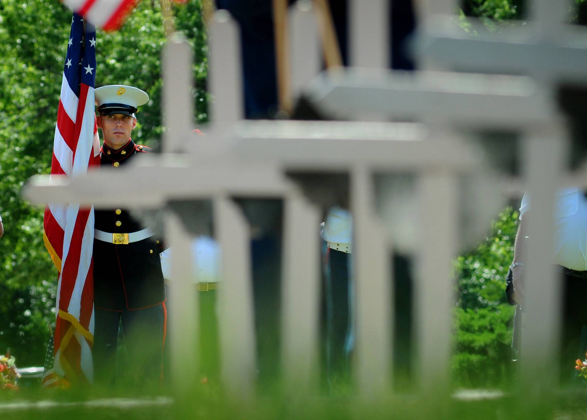 Sgt. Brandon Uhrich, of the U.S. Marine Corps, participates with the Tri-Rivers Detachtment of the Marine Corps League Monday, May 26, 2014, in a Memorial Day ceremony at Roselawn Memorial Park in Salina, Kan. Uhrich, of Grand Forks, North Dakota, is a Marine Corps recruiter stationed in Salina.