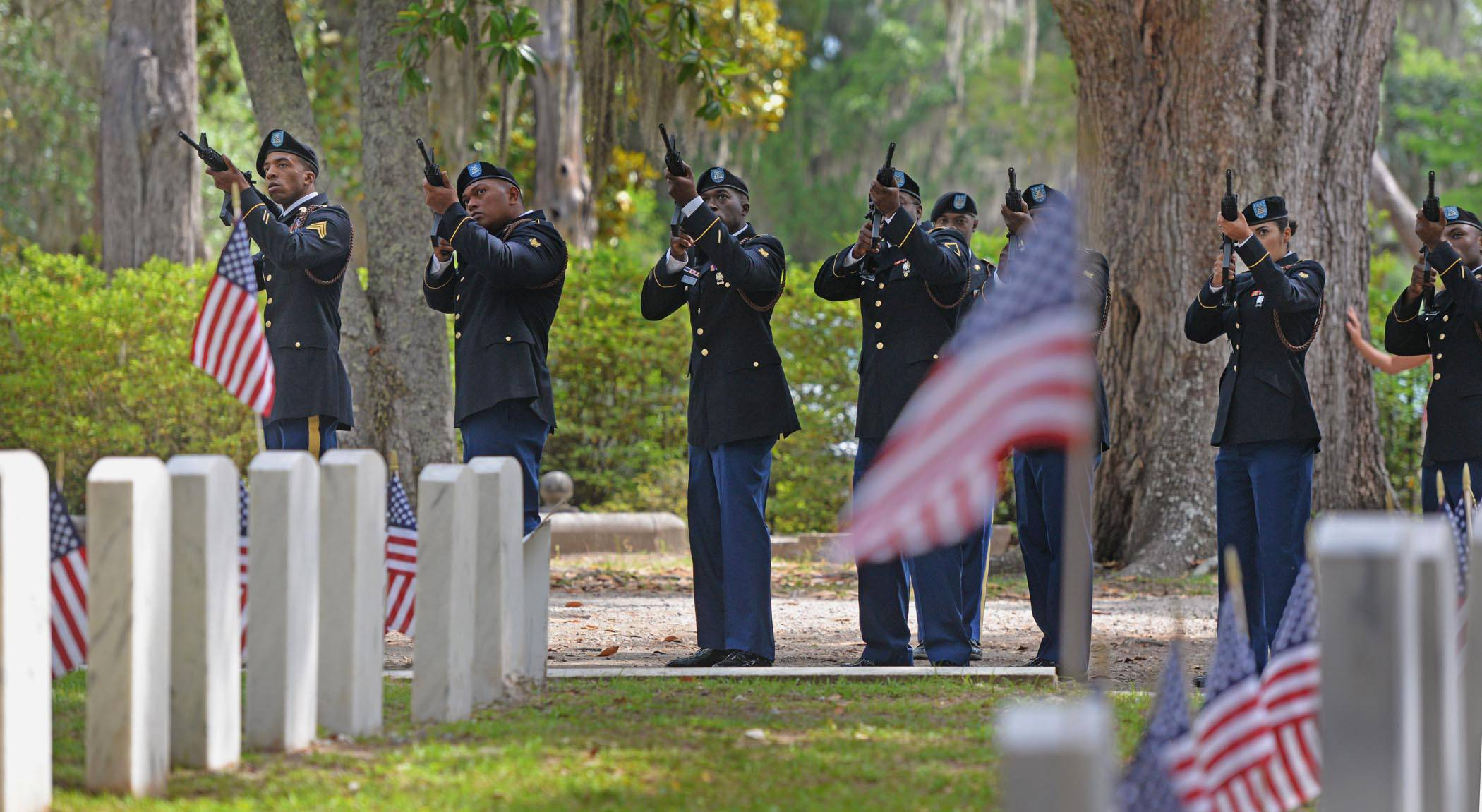 Soldiers from the 3rd Infantry Division fire three volleys Monday, May 26, 2014, during a Memorial Day ceremony at Bonaventure Cemetery in Savannah, Ga.
