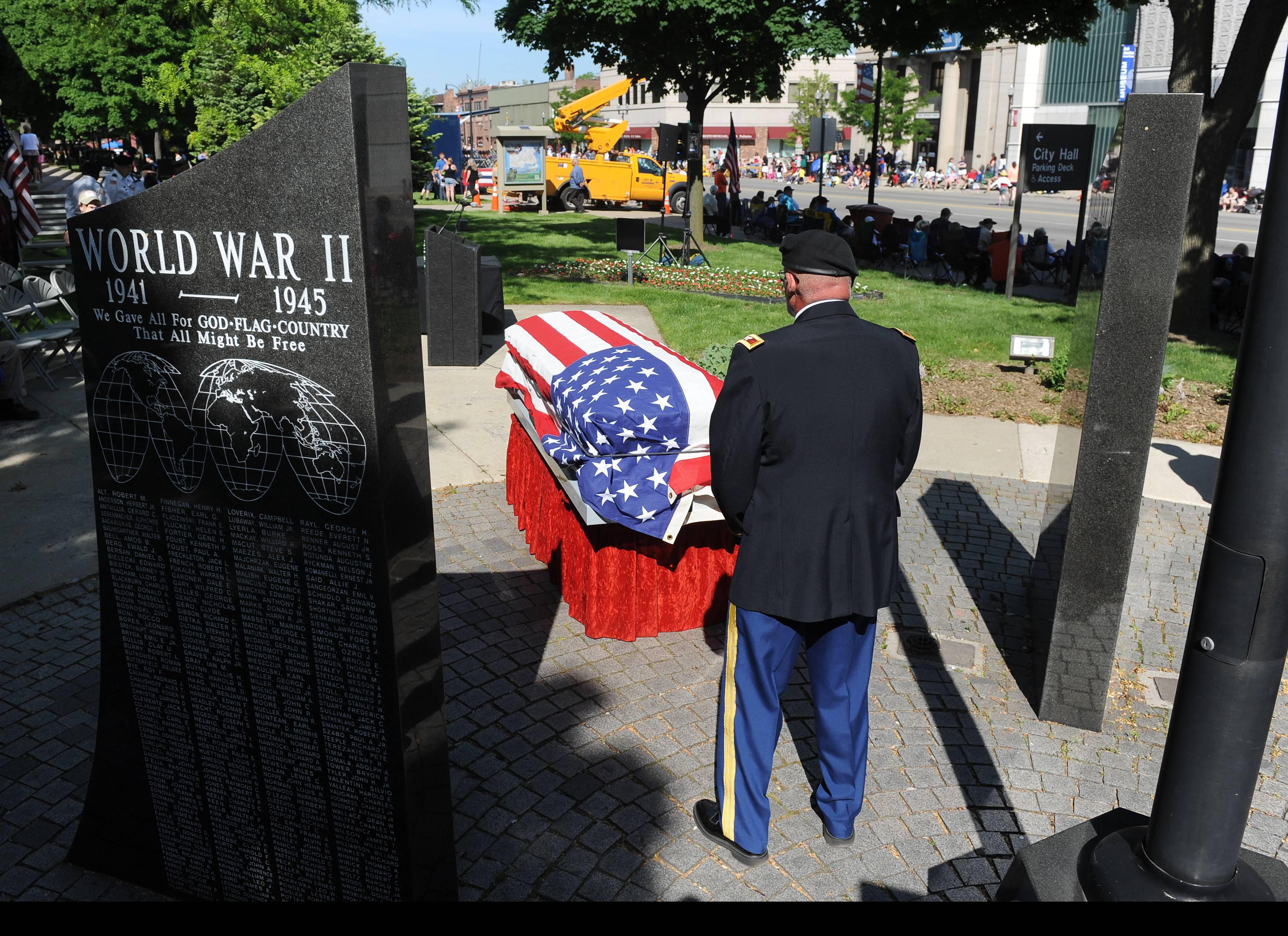 U.S. Army Col. Keith Sousa is honored to stand guard over the remains of five Michigan soldiers, that were given tribute, at the Dearborn Memorial Day Parade in Dearborn, Mich., on Saturday, May 26, 2014.