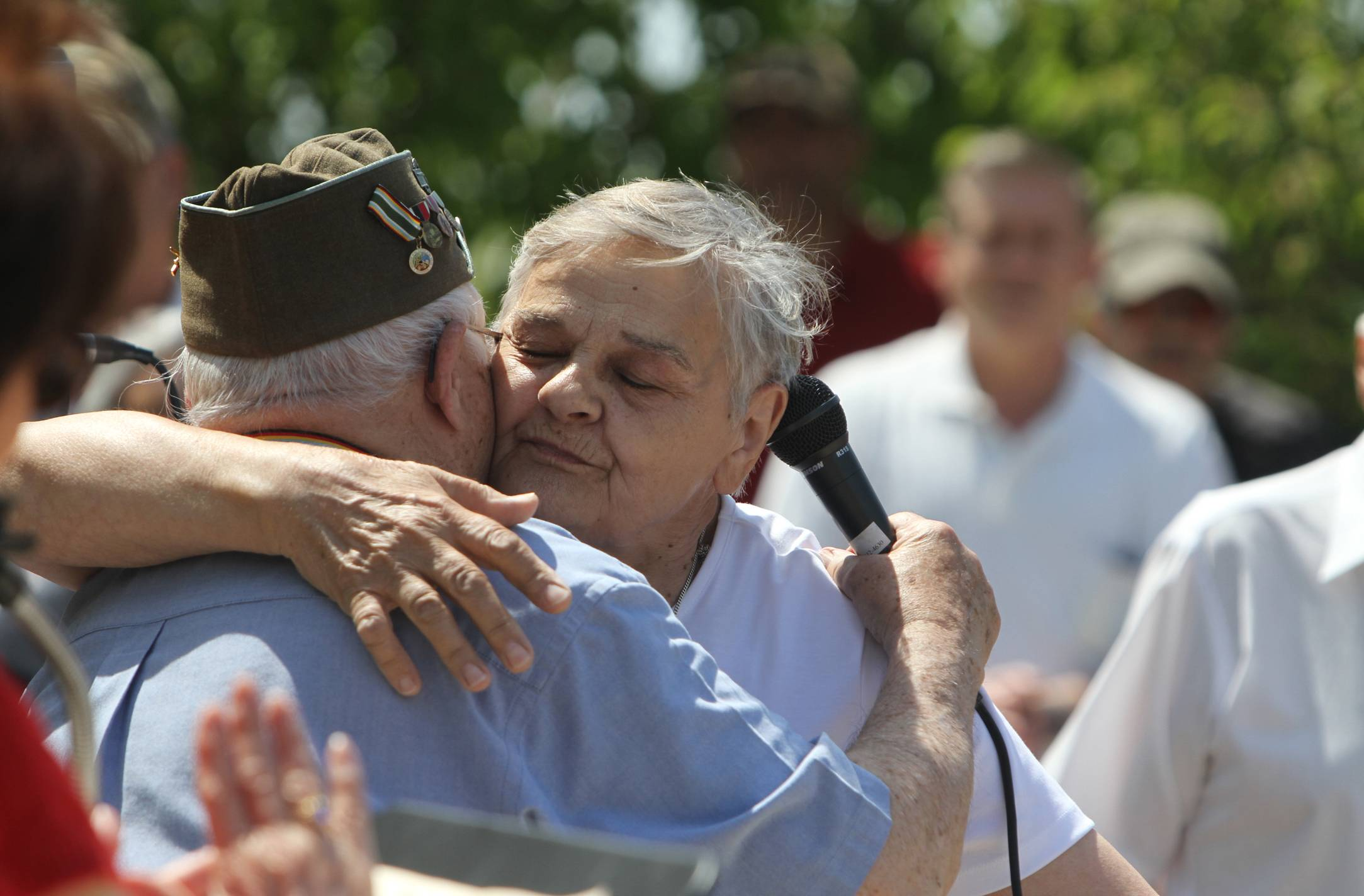 Elisabeth Blaakman, hugs John Foy of Greece, N.Y., during the Veterans of the Battle of the Bulge Memorial Day Ceremony at Ontario Beach in Rochester, N.Y., Monday, May 26, 2014. Blaakman was a child in Holland during WW II and thanked all the veterans that were there for liberating her country during the ceremony. Foy was an infantry machine-gunner in George Patton's Third Army during the Battle of the Bulge.