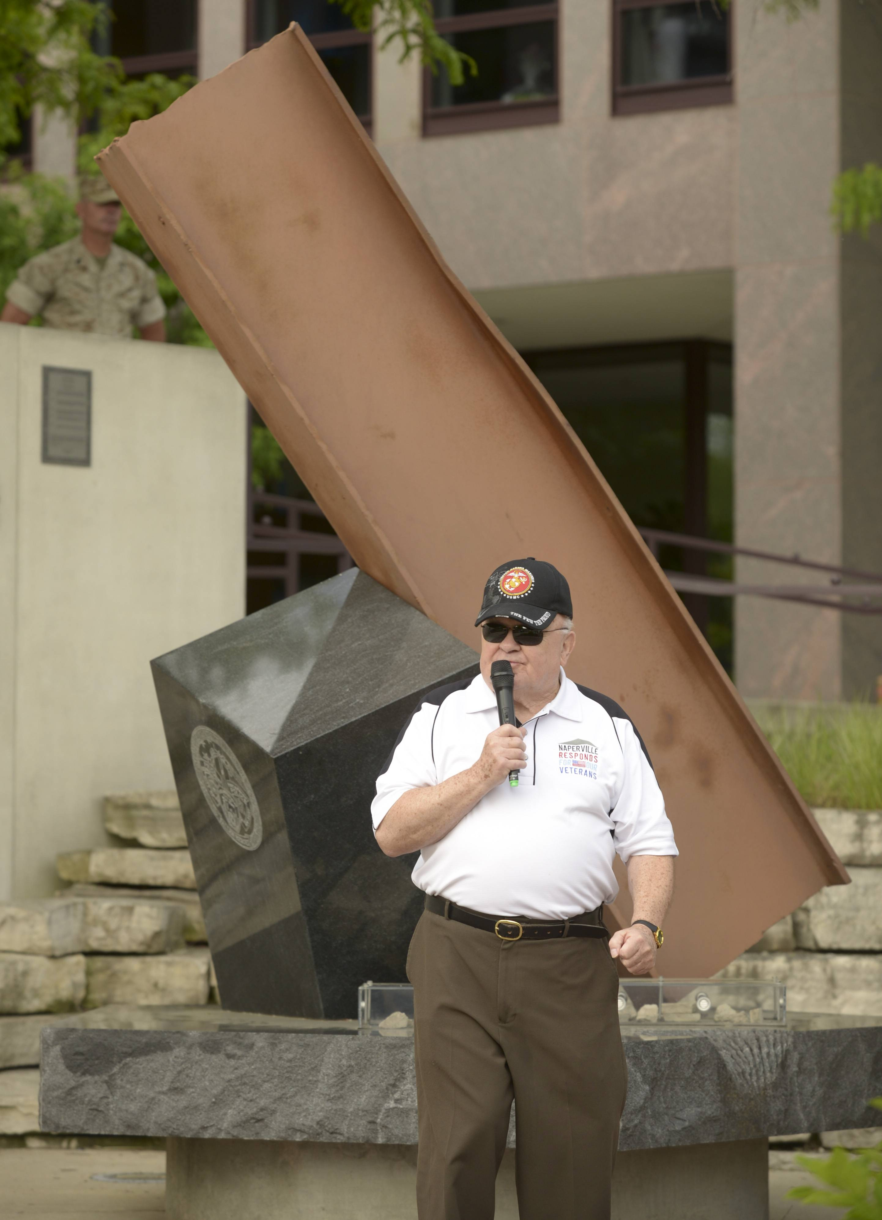 Naperville Mayor George Pradel, a Marine veteran, addresses those attending the city's Memorial Day service Monday morning at the Cmdr. Dan Shanower Sept. 11 memorial.