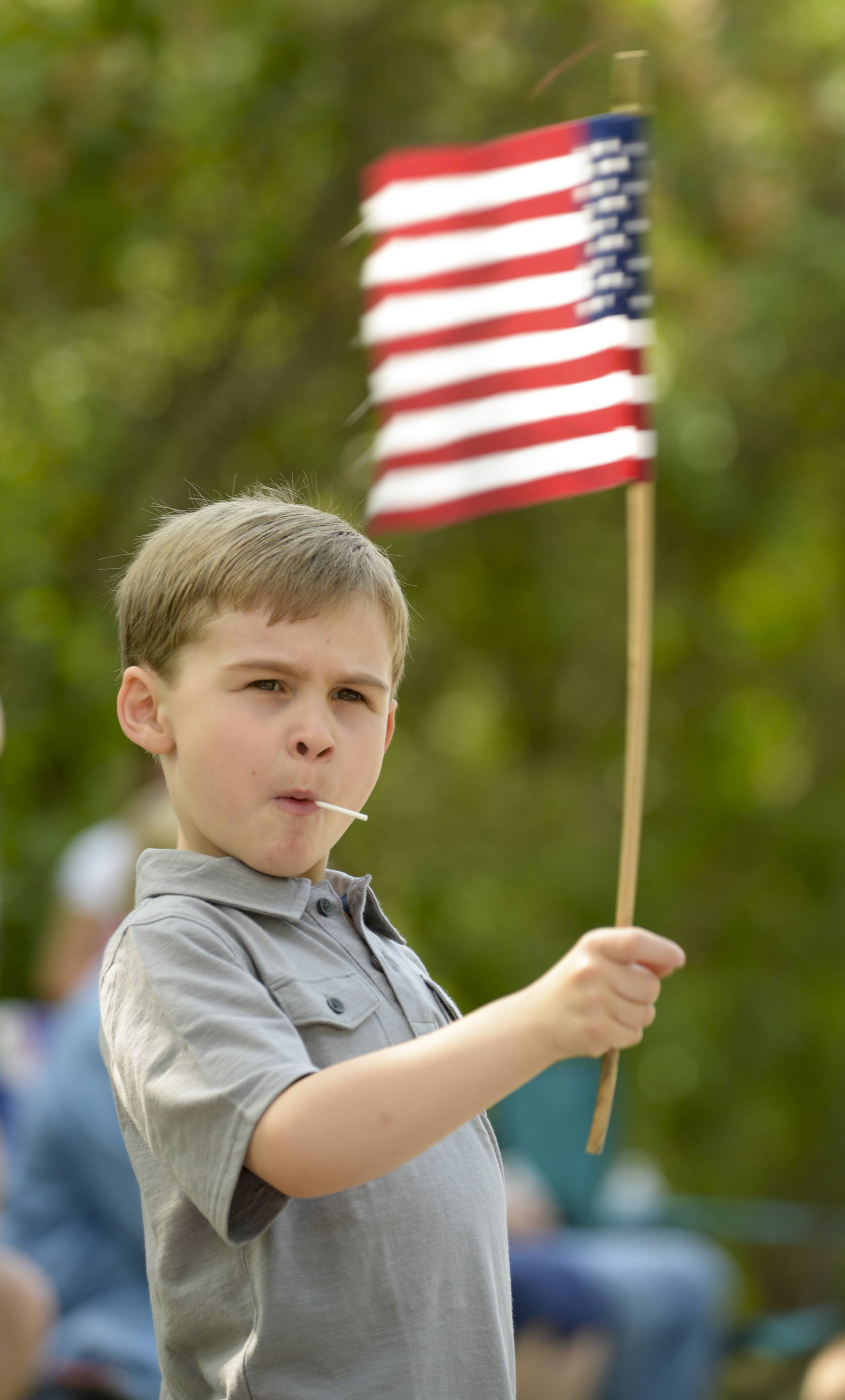 Eli Adams, 6, of Wheaton, shows his patriotism during the city's Memorial Day parade.