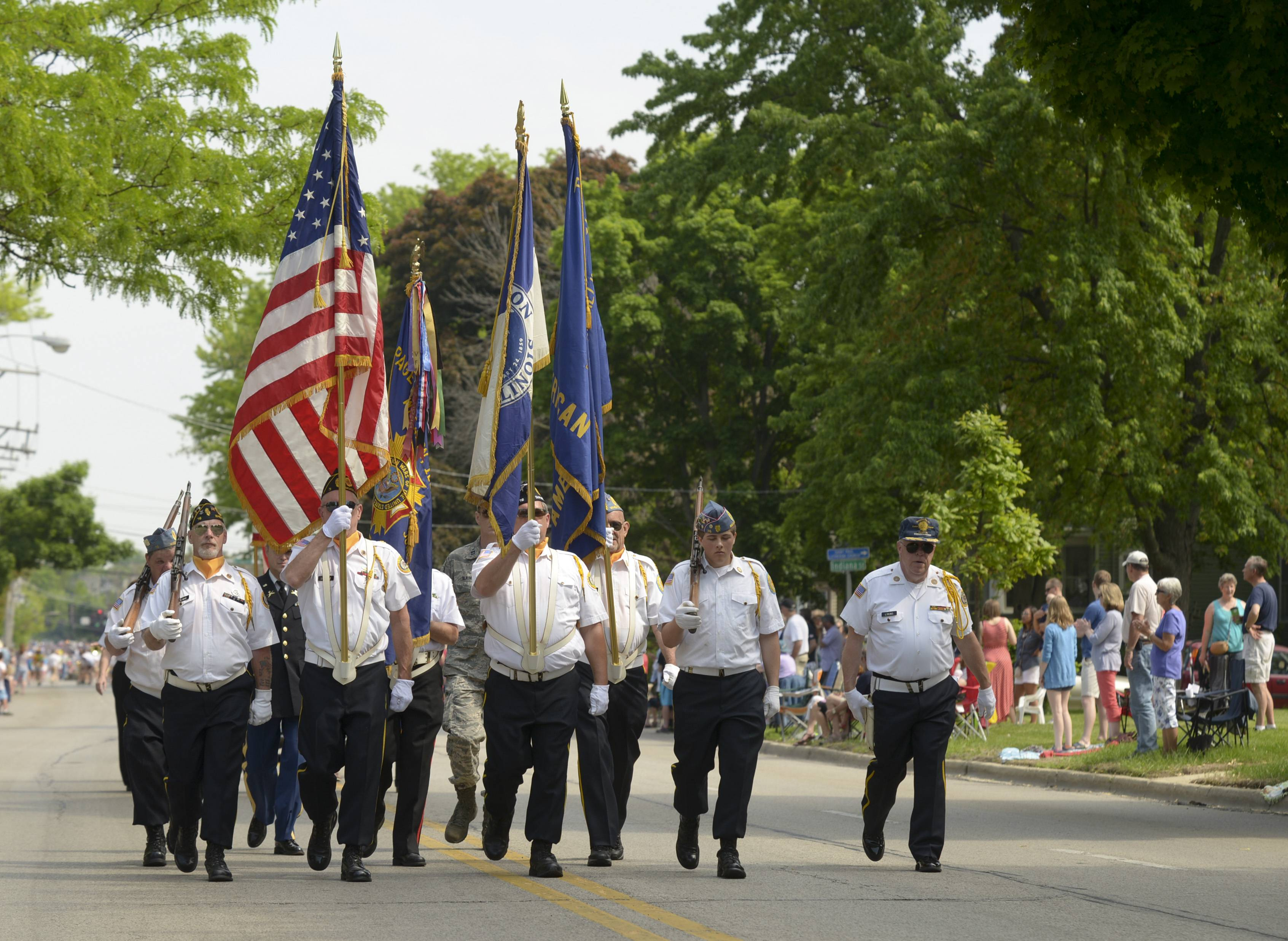 American Legion and the VFW members march in the Wheaton Memorial Day parade.