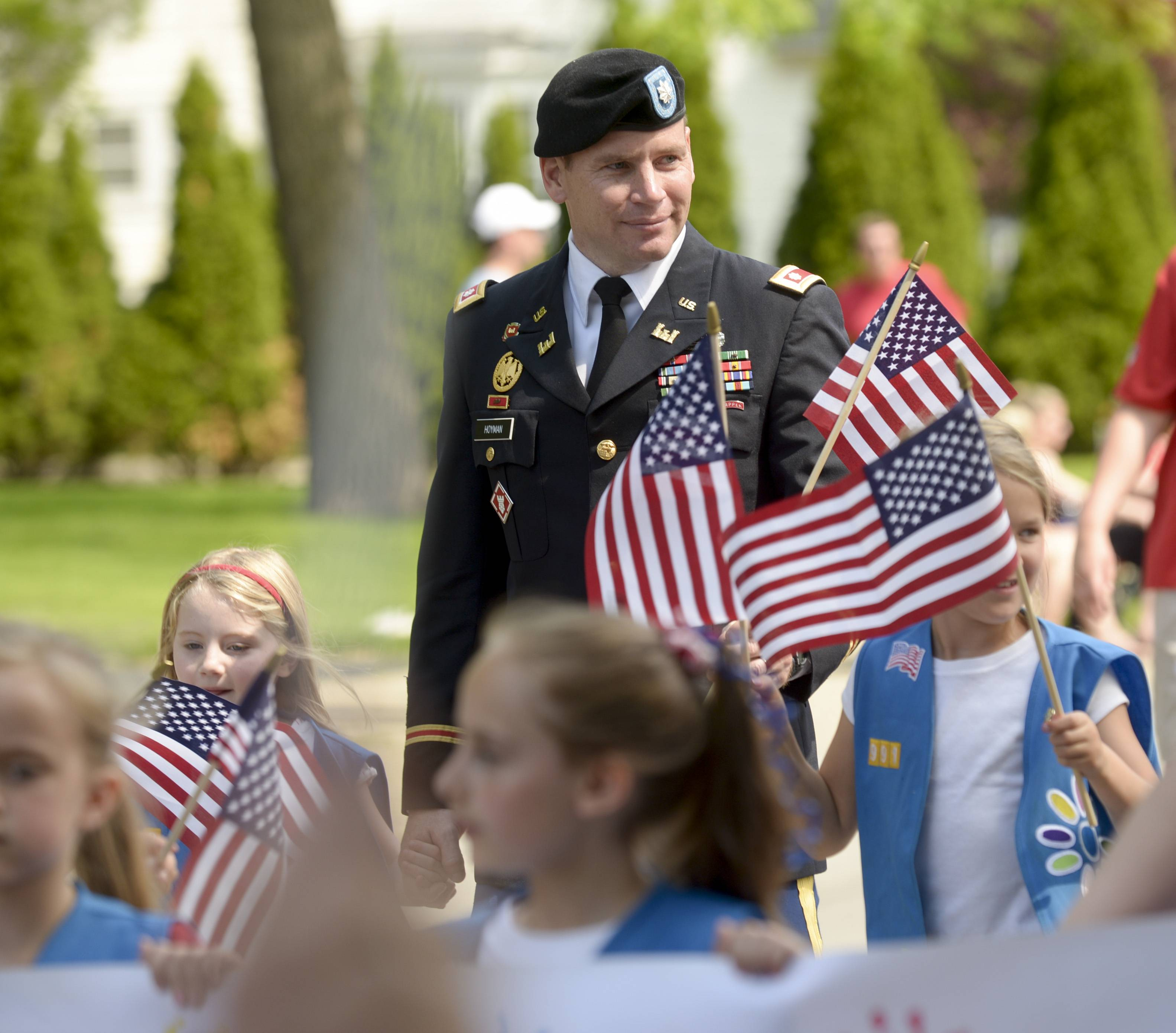 Army Lieutenant Colonel Jim Hoyman of Wheaton marches in the Wheaton Memorial Day parade with his daughter Paige's Daisy Troop from Washington School.