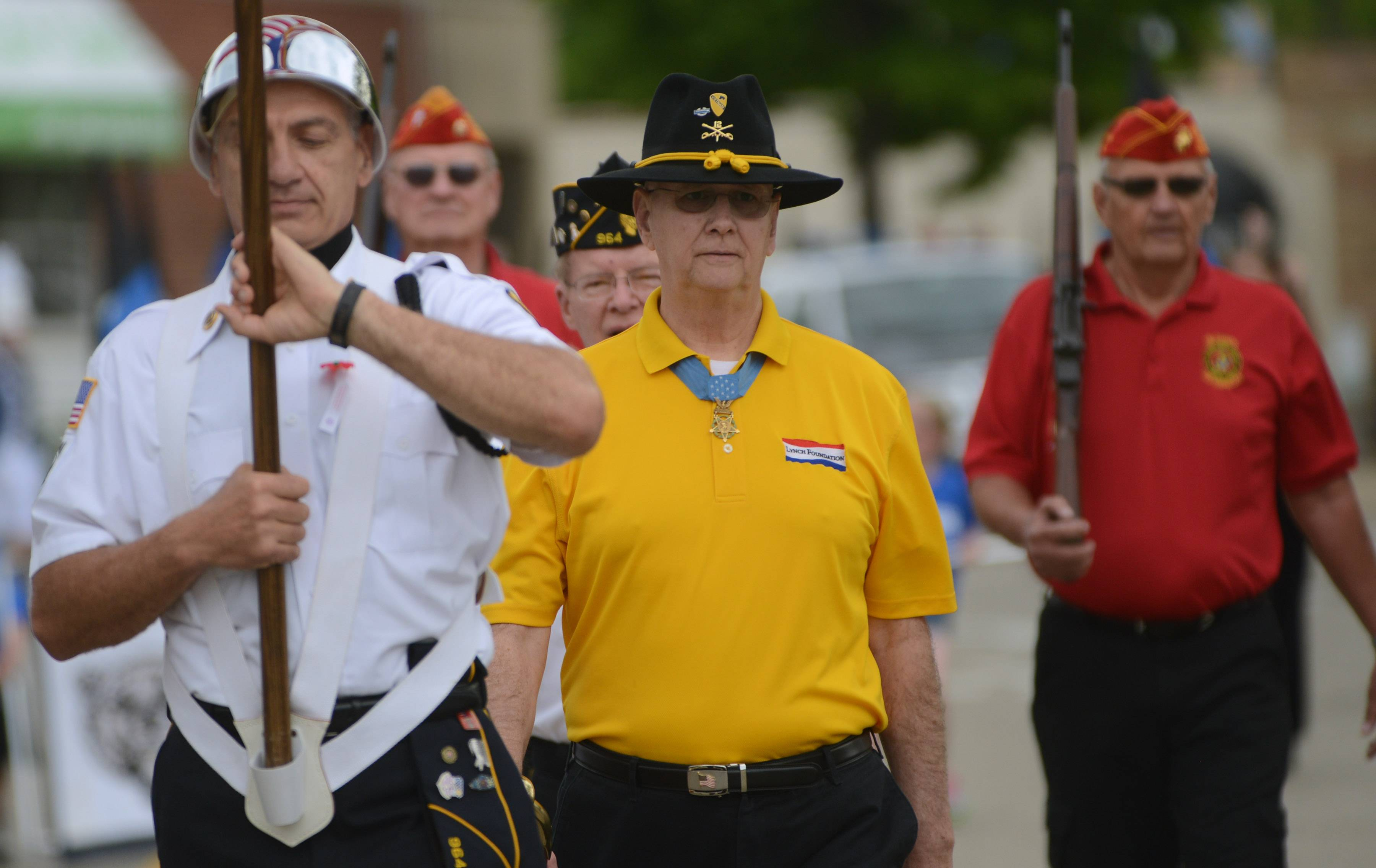 Medal of Honor recipient Allen J. Lynch of Gurnee walks in the Lake Zurich Memorial Day parade Monday.
