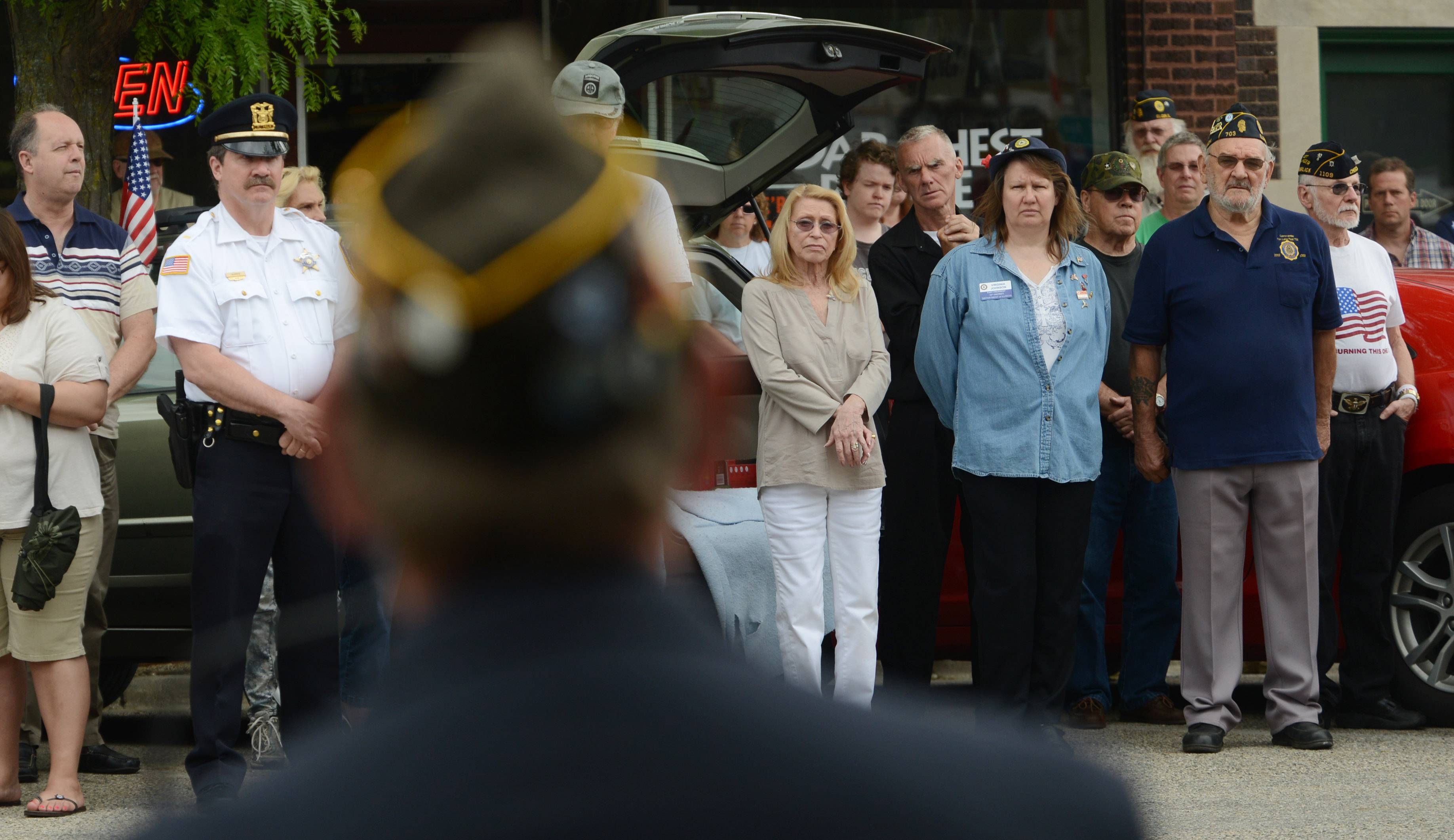 Speakers share the history of Memorial Day during a ceremony in downtown Fox Lake Monday morning.
