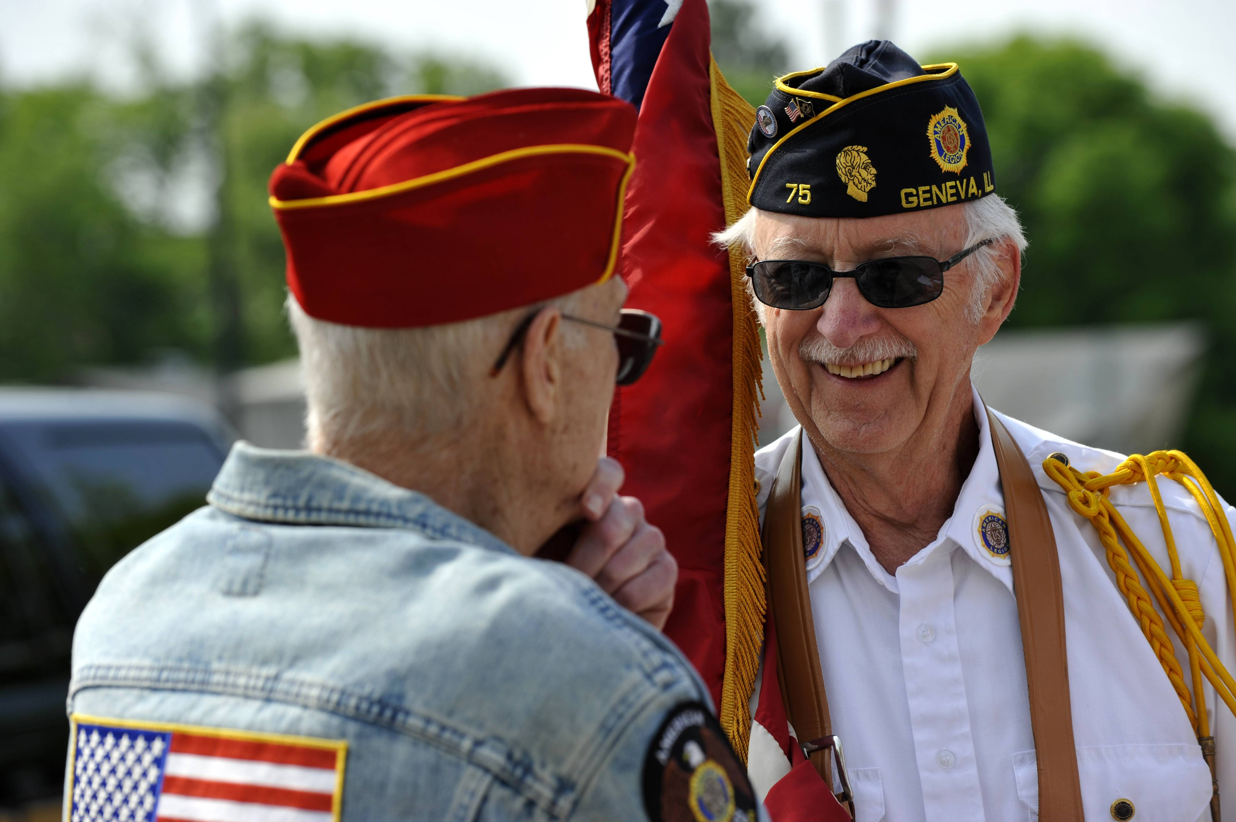 David Pierson of Geneva, left, speaks with Leonard Pietrusiewicz of Geneva before the start of the Geneva Memorial Day Parade on Monday. Pierson is a Veteran of the Korean War and Pietrusiewicz served in the air force from 1954-1957.