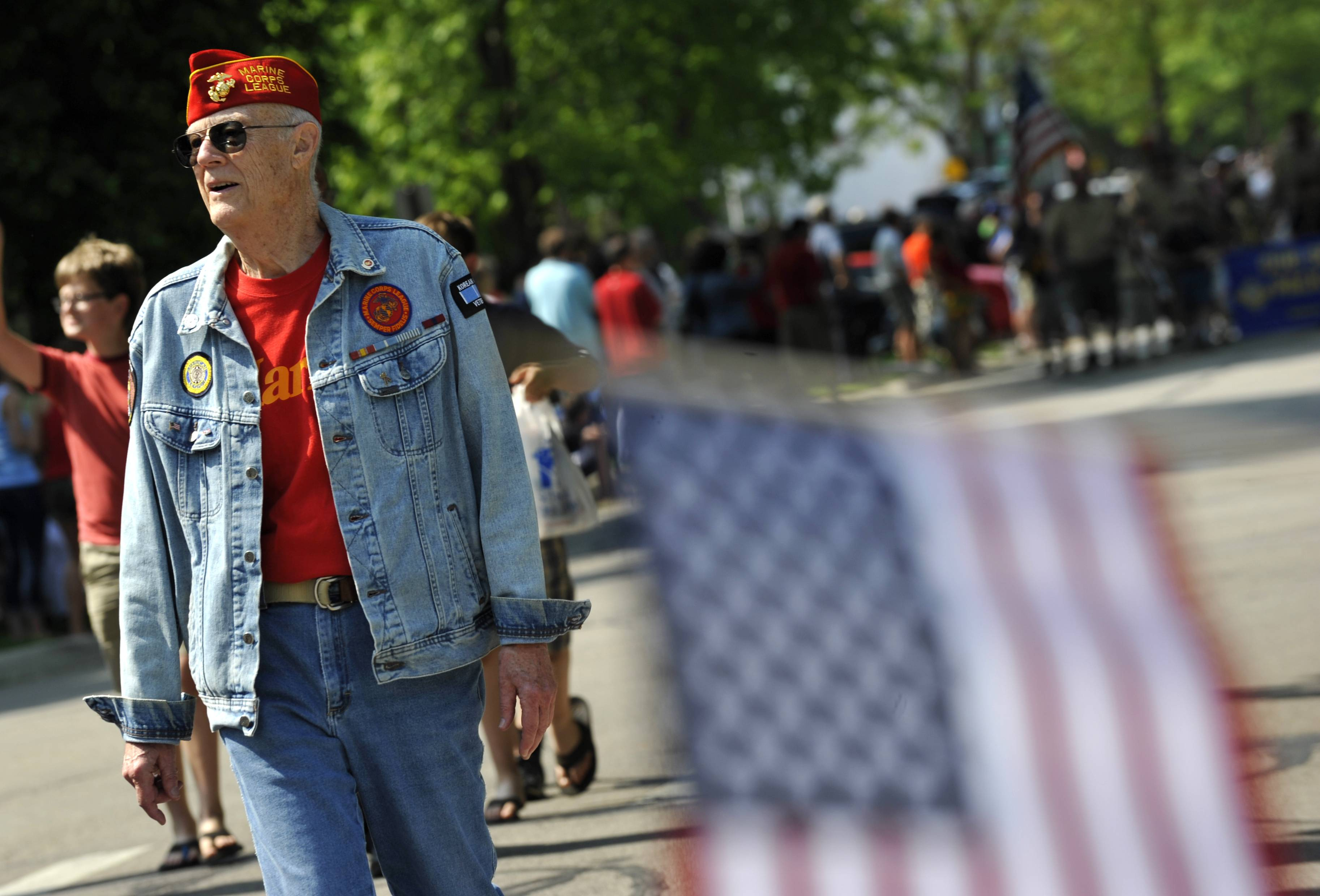 David Pierson of Geneva walks down Third Street during the Geneva Memorial Day Parade on Monday. Pierson is a Veteran of the Korean War.