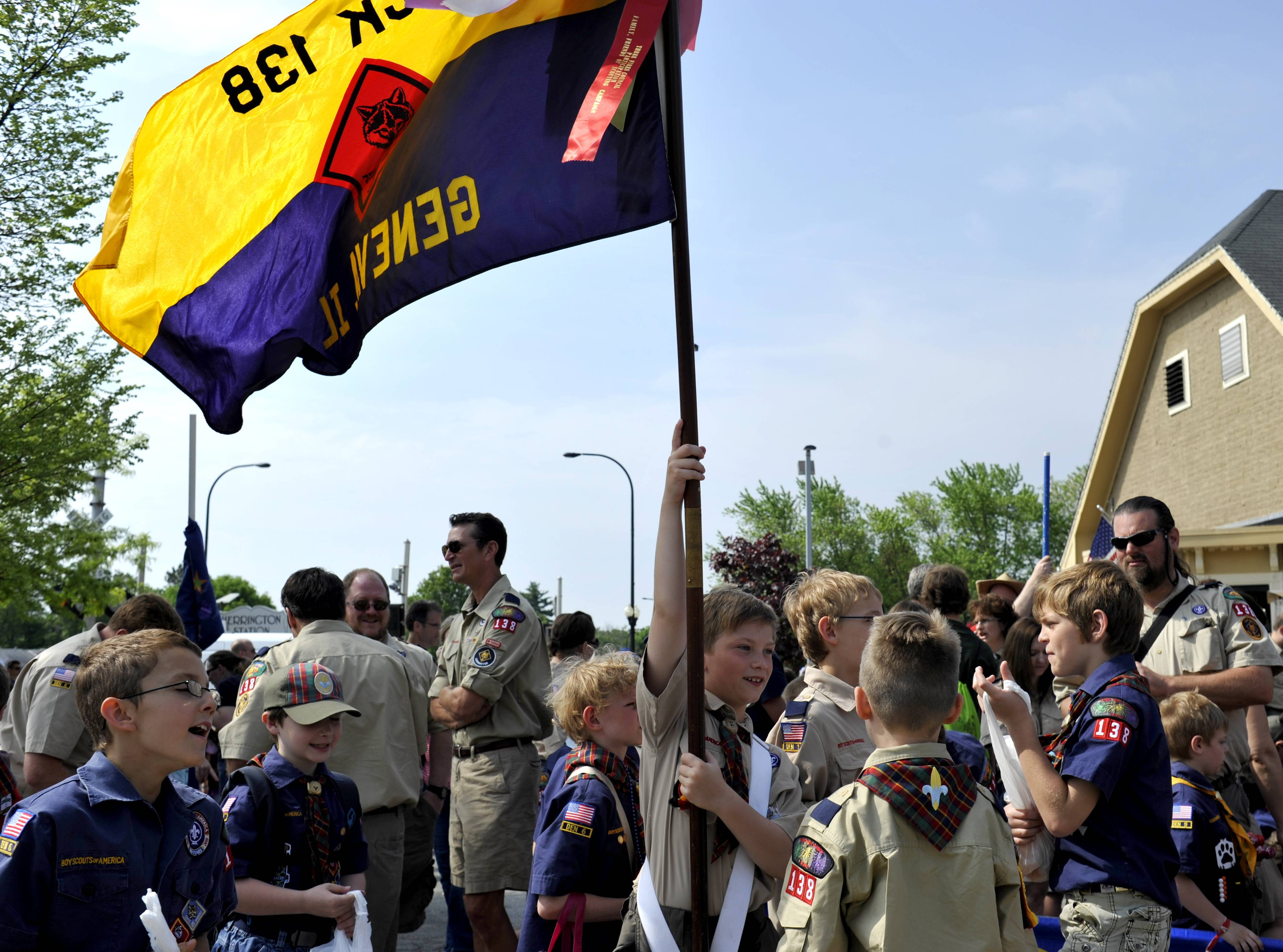 Dylan Funkhouser, 9, of Geneva (center) holds the flag for Cubscout Pack 138 before the start of the Geneva Memorial Day Parade on Monday.