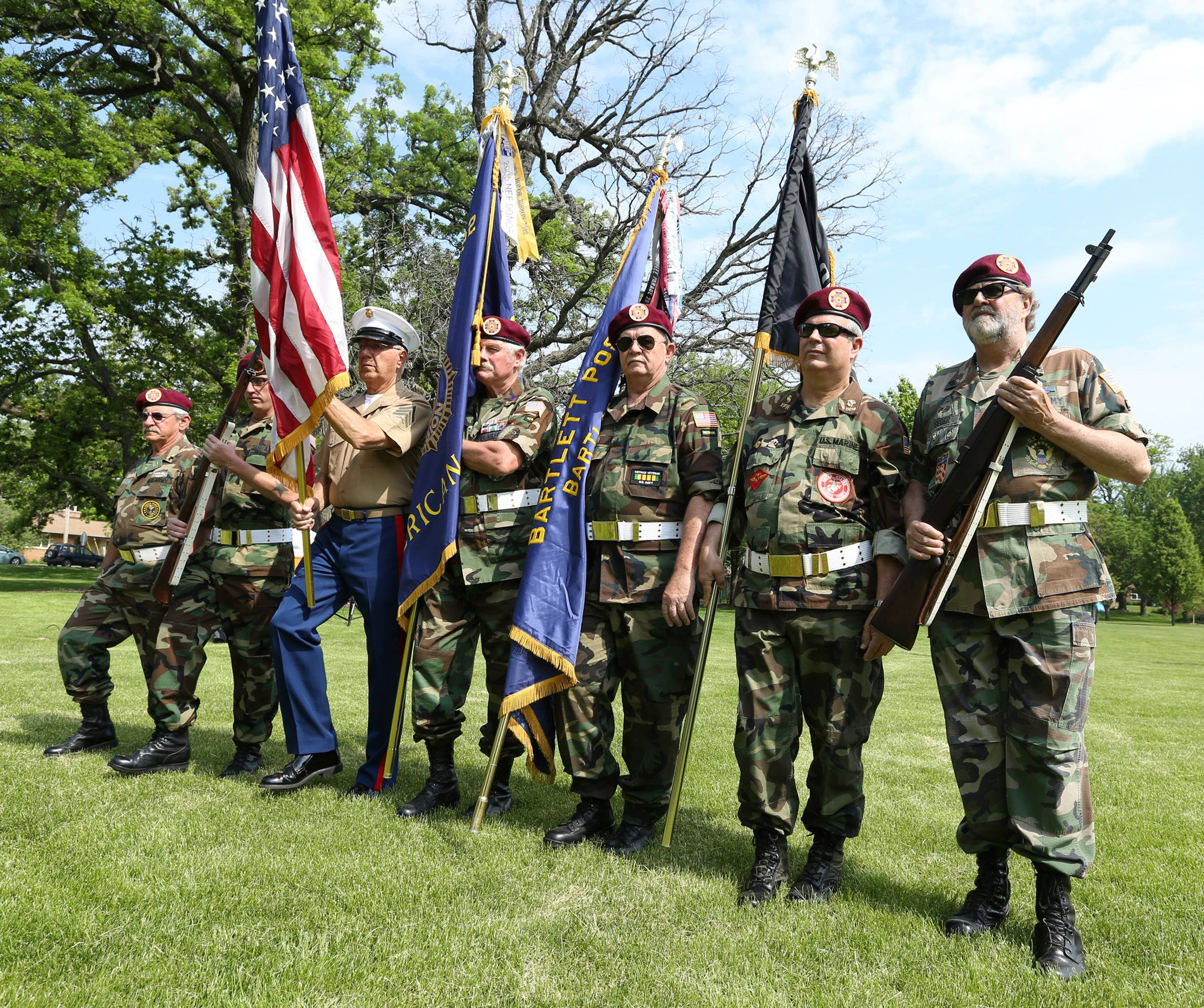 The color guard marches into Bartlett Park for a flag retirement ceremony held by Bartlett VFW Post 11018 and American Legion Post 1212 on Memorial Day.