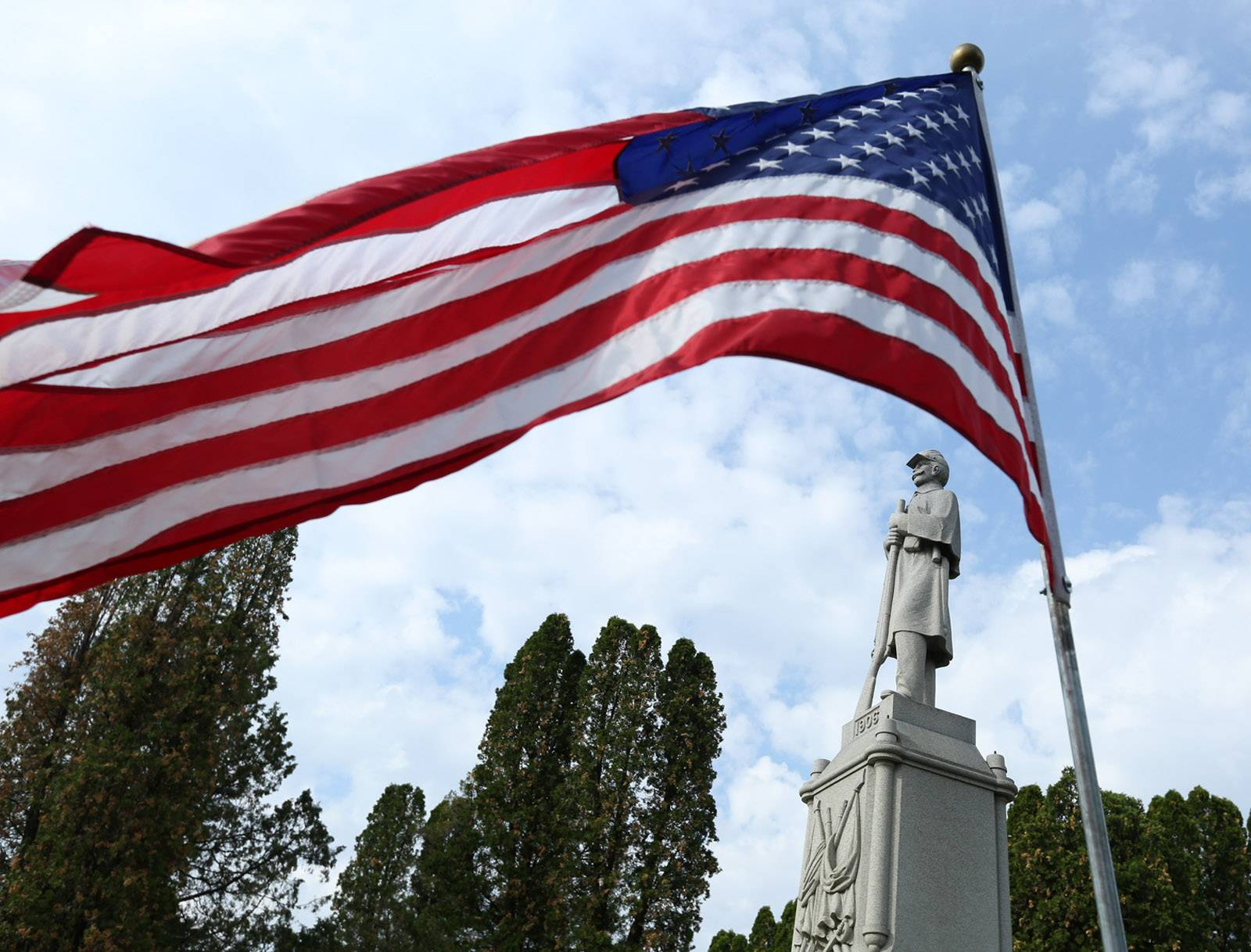 An American flag flies on Memorial Day at the Evergreen Cemetery in Barrington.