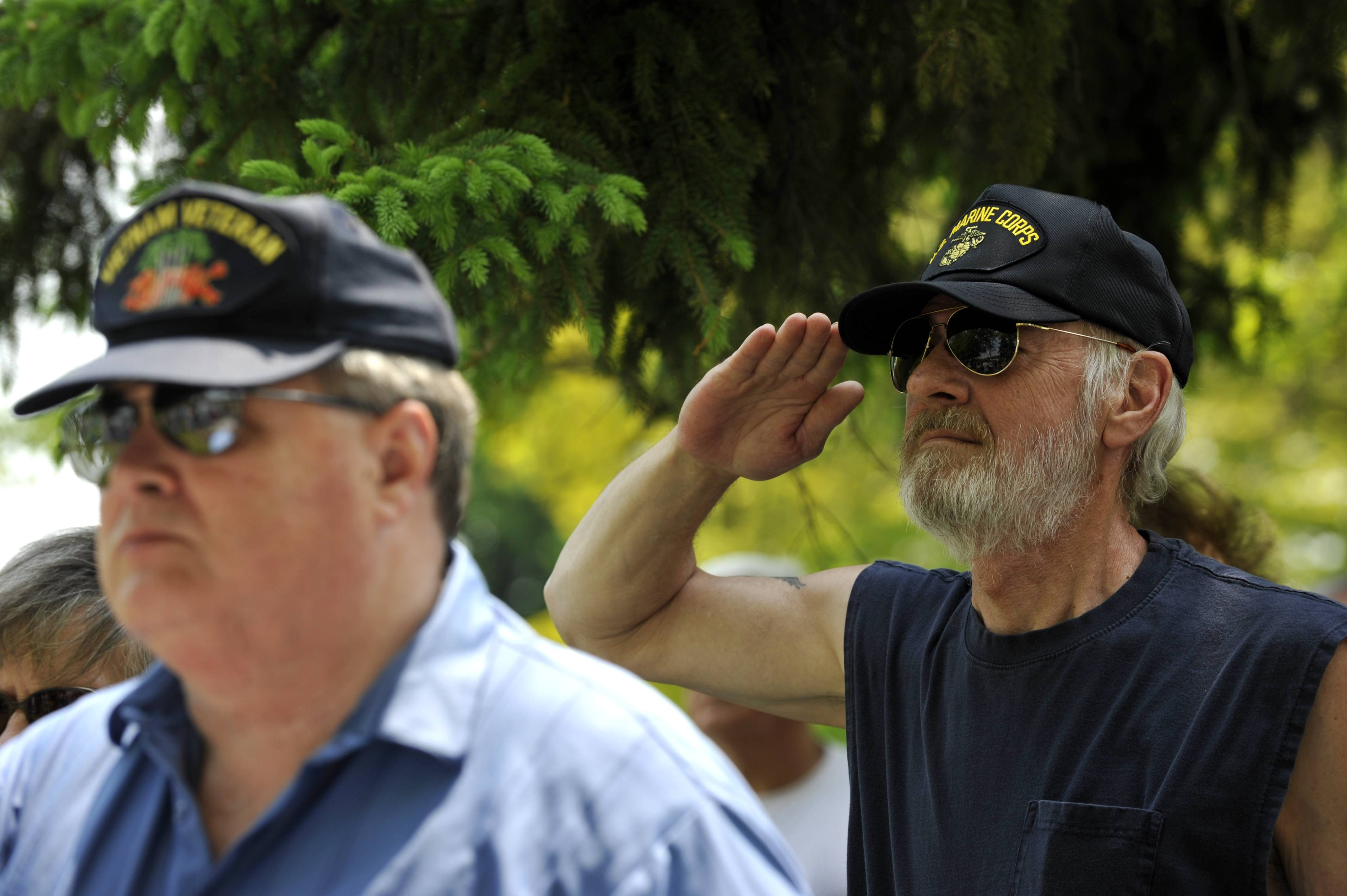 Jack Hosey of Elgin (right), a Vietnam War Veteran, gives salute during the Memorial Day Service at River Valley Memorial Gardens in West Dundee on Monday, May 26. Also pictured is Michael Pearson of Carpentersville (left), also a Vietnam War Veteran.