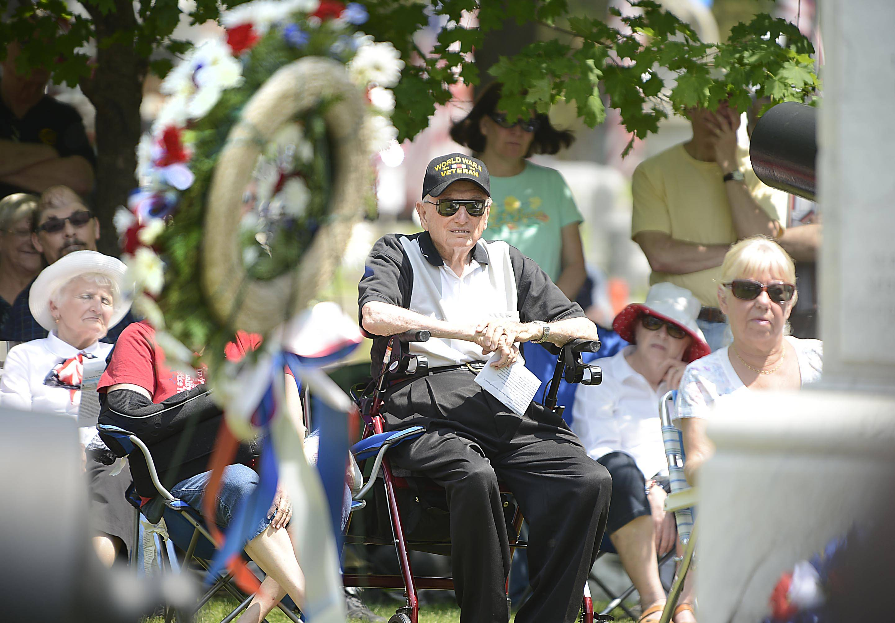 Howard Bedell watches the Elgin Memorial Day event at Bluff City Cemetery Monday. He is 94 years old and served three years in the Pacific during World War II. He lives in Elgin.
